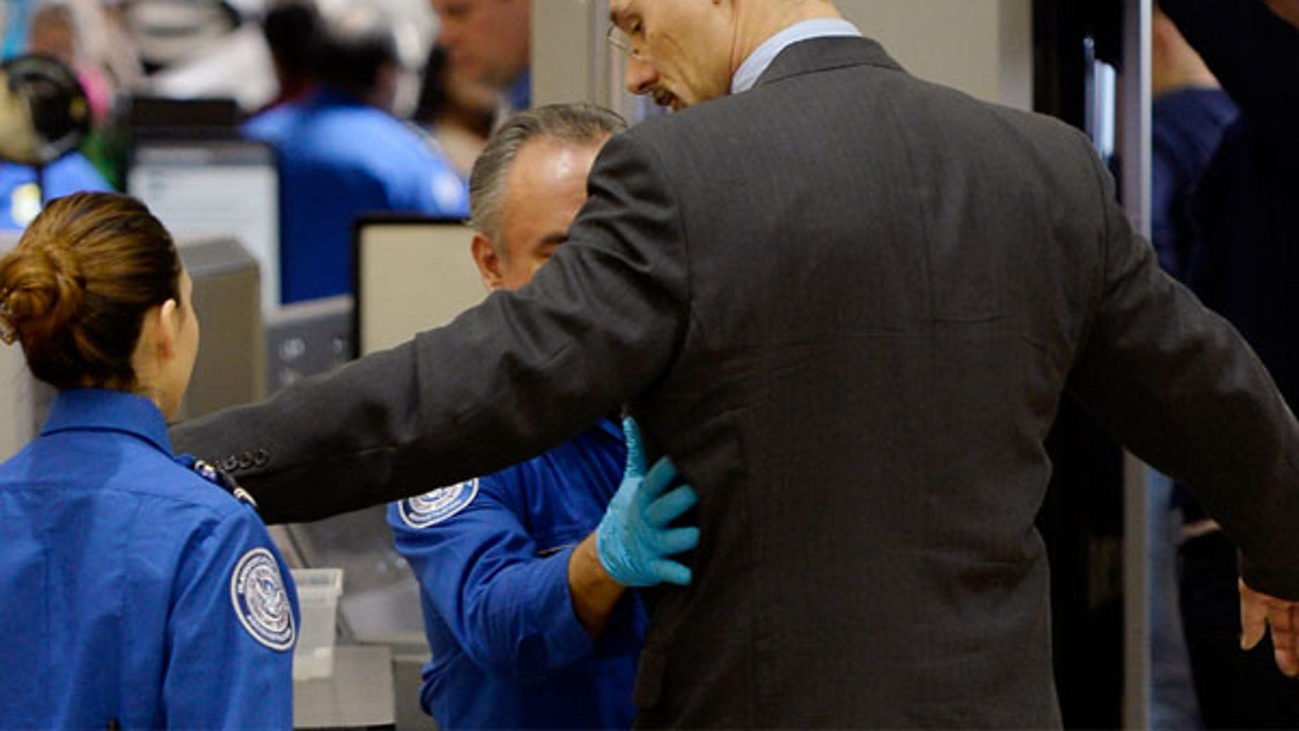 FILE: TSA agents pat-down a passenger at Los Angeles international Airport.