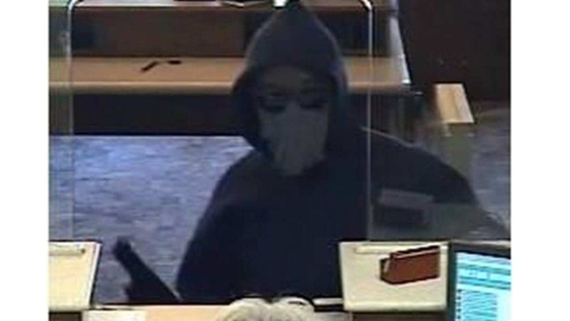 """Video image shows the """"Incognito Bandit"""" holding up a bank in Wobum, Massachusetts, on Sept. 5, 2015."""