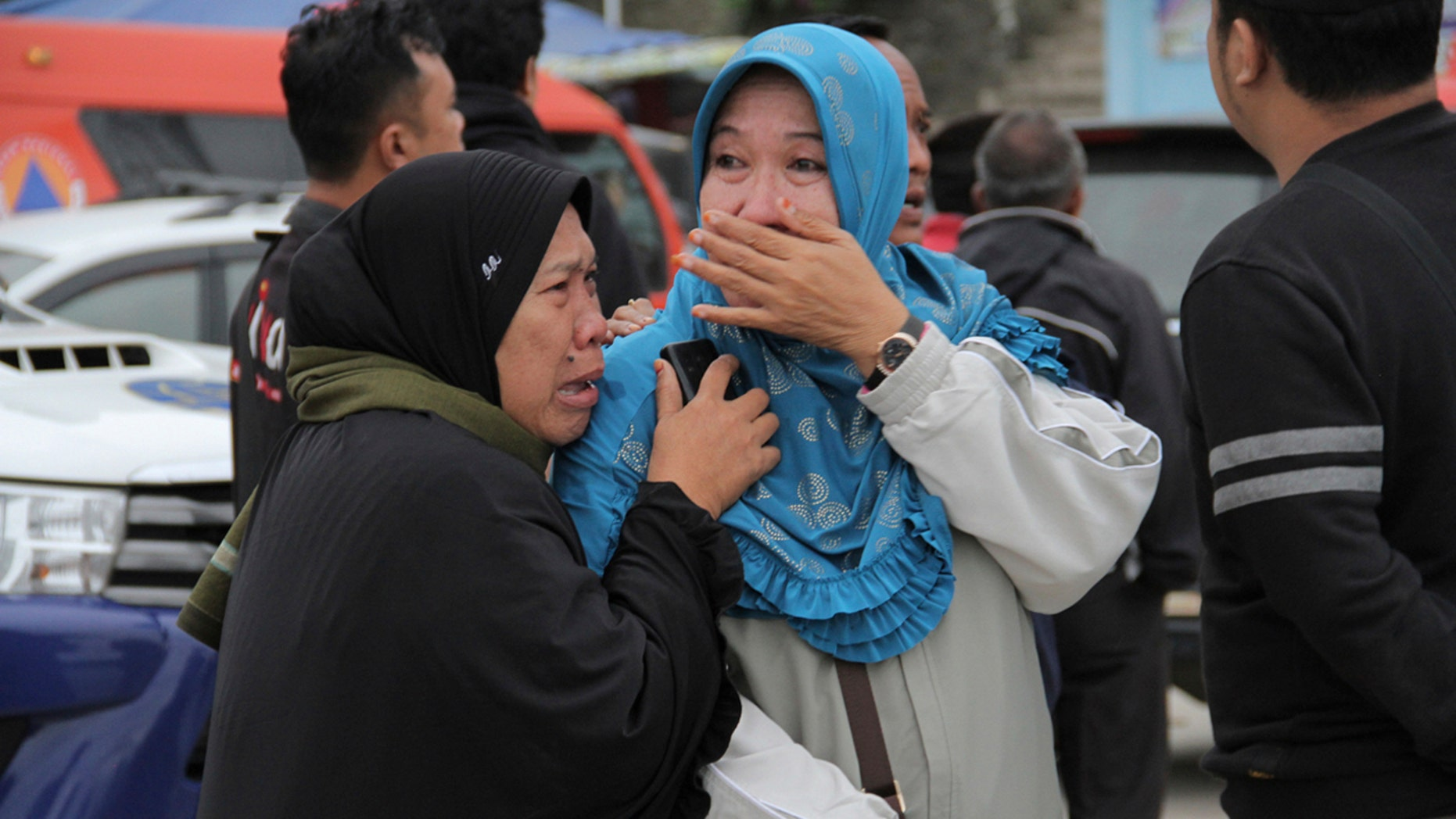 Relatives weep at Tigaras port after learning that their family members are among the passengers of a ferry which sank on Monday, in Simalungun, North Sumatera, Indonesia, Tuesday, June 19, 2018.
