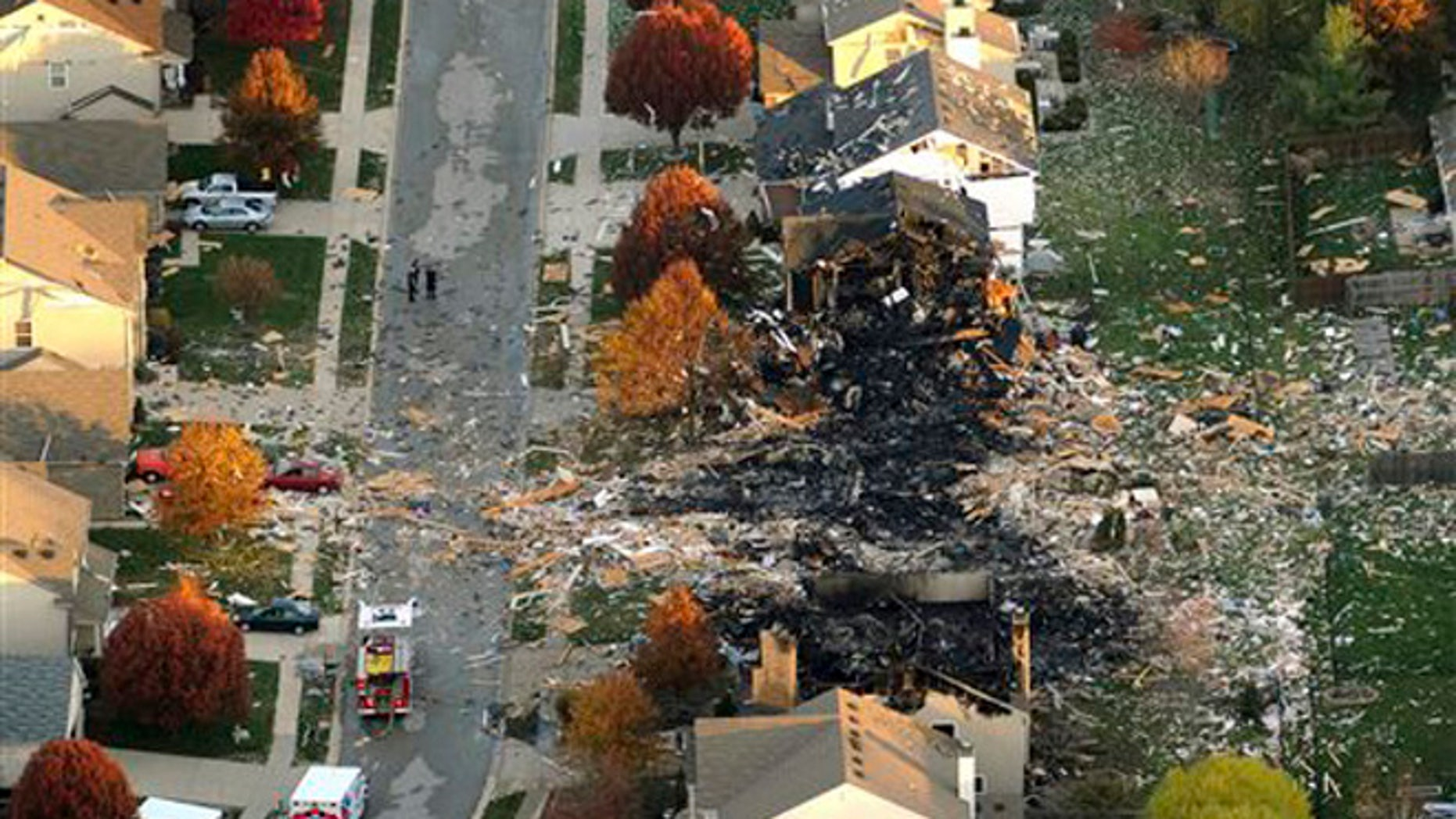 In this Nov. 11, 2012 file aerial photo, two homes that were leveled and the numerous neighboring homes that were damaged from a massive explosion that sparked a huge fire and killed two people are shown in Indianapolis.