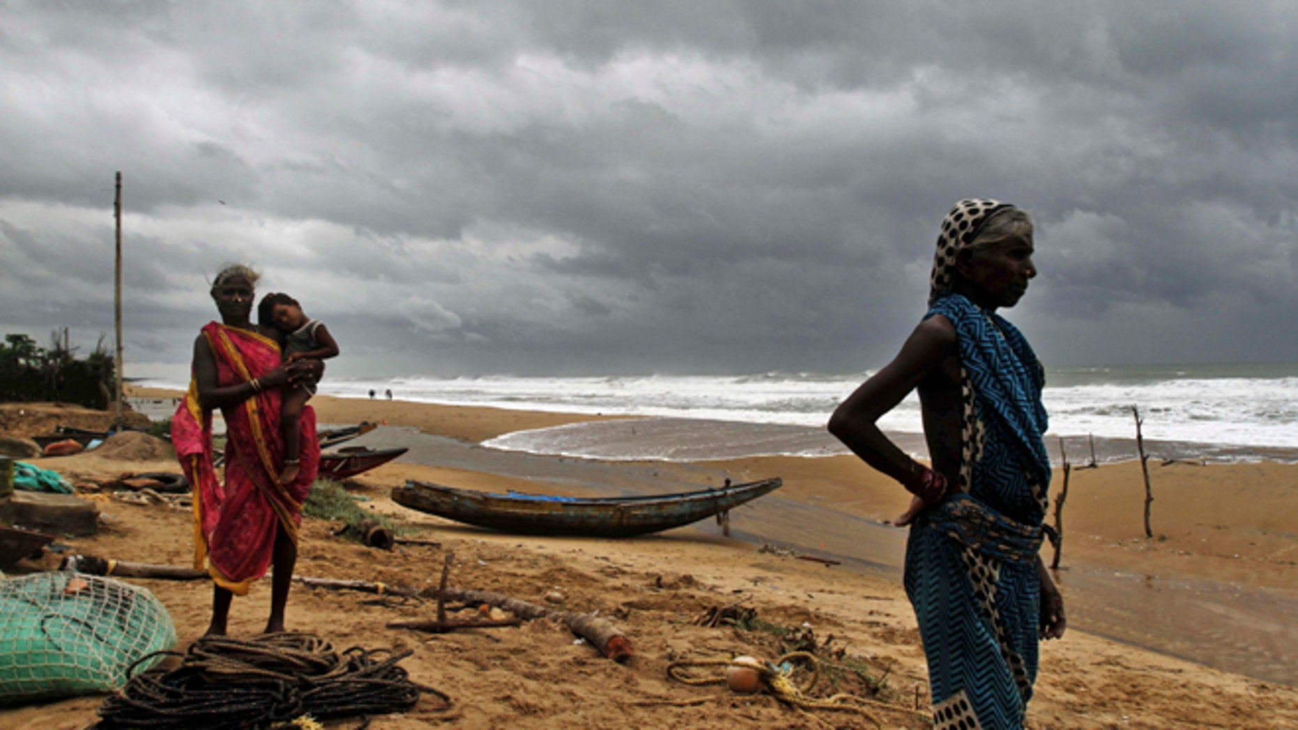 Oct. 11, 2014: Fisherwomen watch the sea waves before evacuating the place near Podampeta village, on the outskirts of Gopalpur beach in Ganjam district, 140 kilometers (87 miles) south of Bhubaneswar, India.
