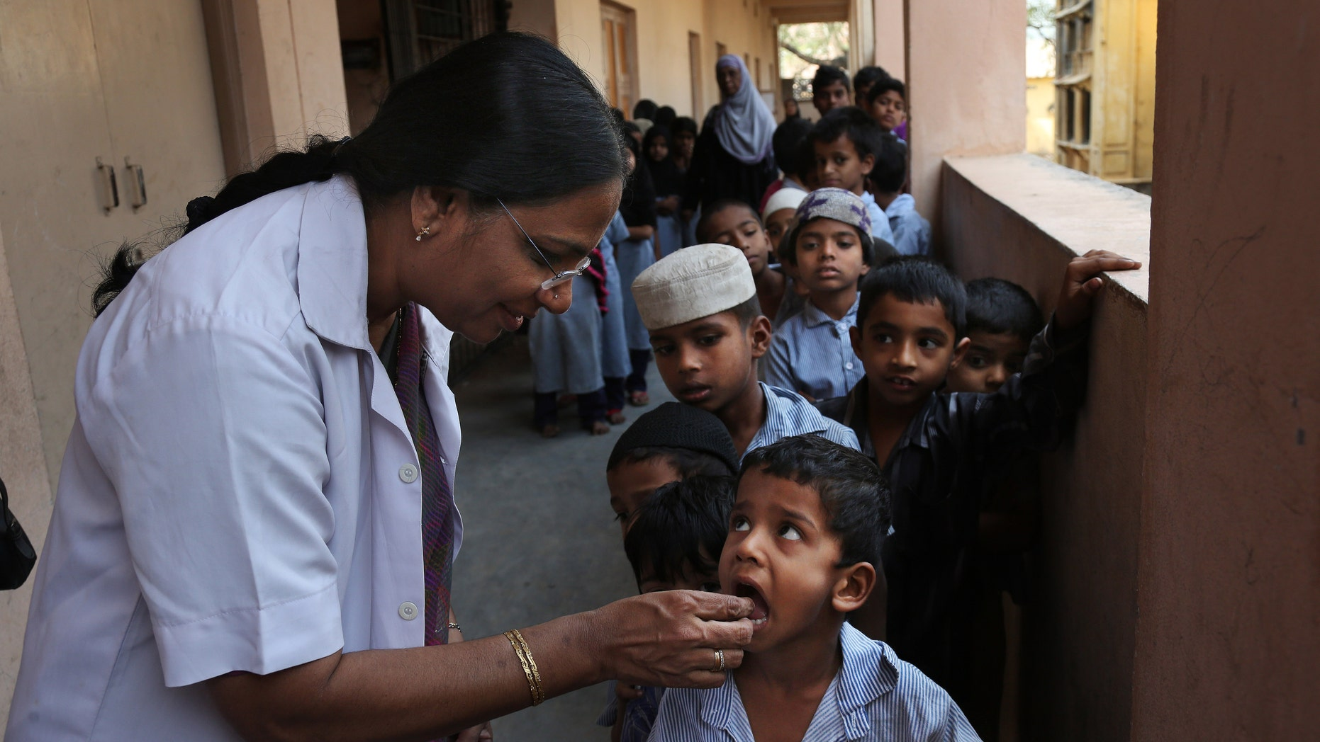 Feb. 10, 2016: Indian schoolchildren line up to take a deworming tablet in Hyderabad, India.
