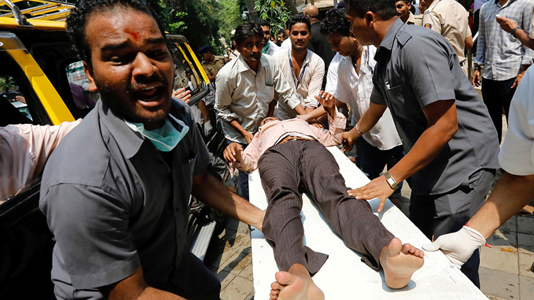 Sept. 29, 2017: A stampede victim is carried on a stretcher at a hospital in Mumbai, India.