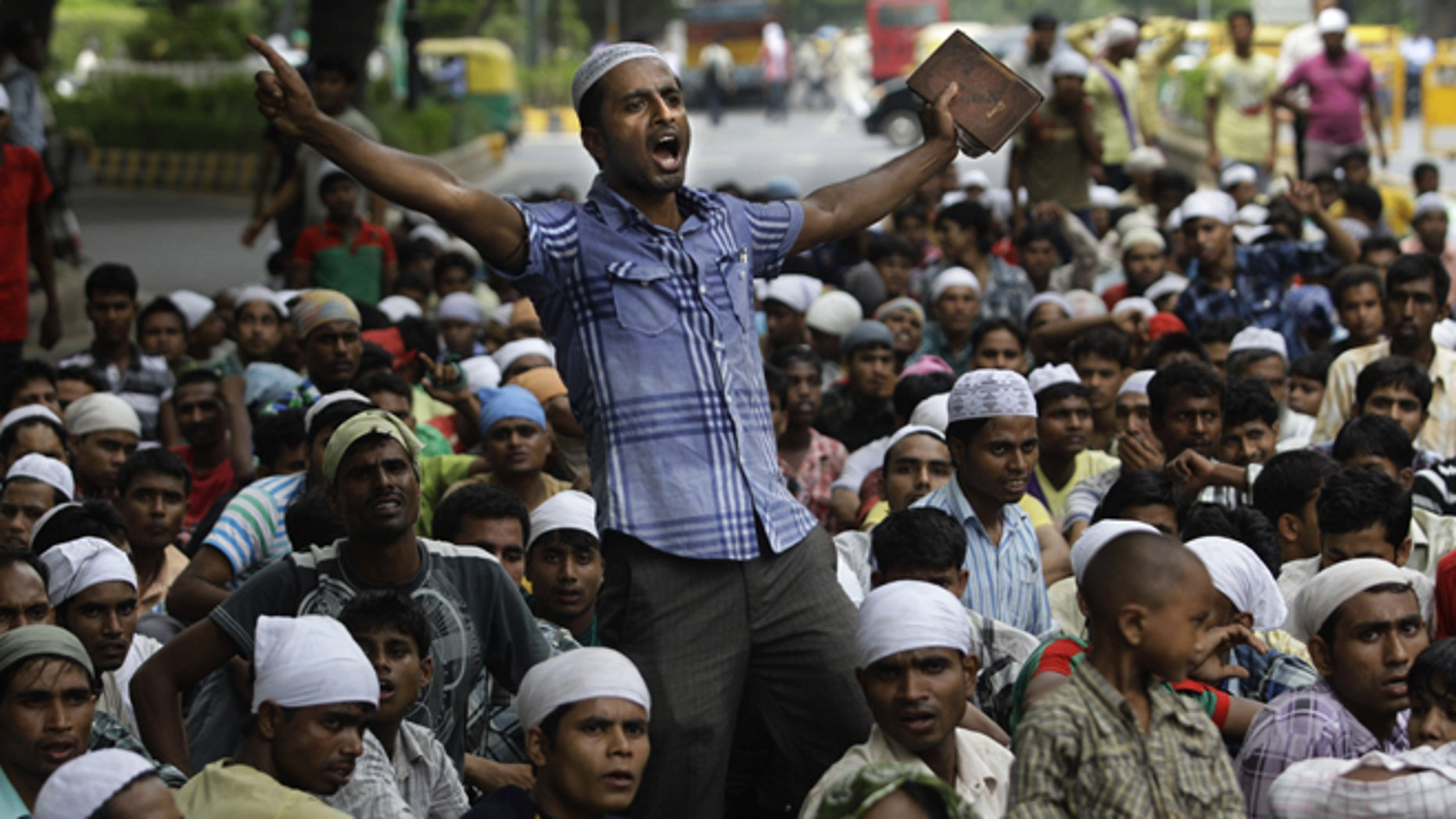 July 25, 2012: Muslims hailing from India's north eastern Assam state and living in New Delhi shout slogans during a protest against the ethnic violence in Assam in New Delhi, India.