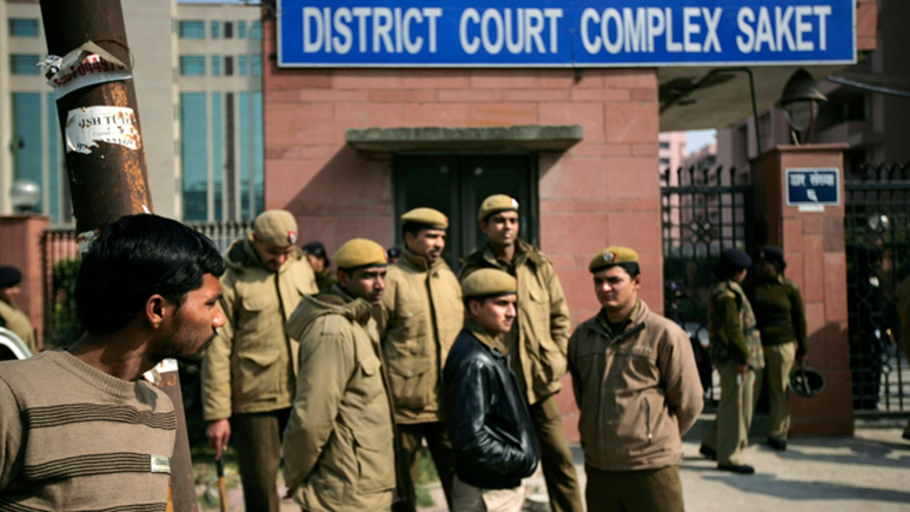 Jan. 24, 2013: Delhi policemen stand guard near the gate of a district court where the accused in the gang rape and murder of a 23-year-old student are undergoing trial, in New Delhi, India.