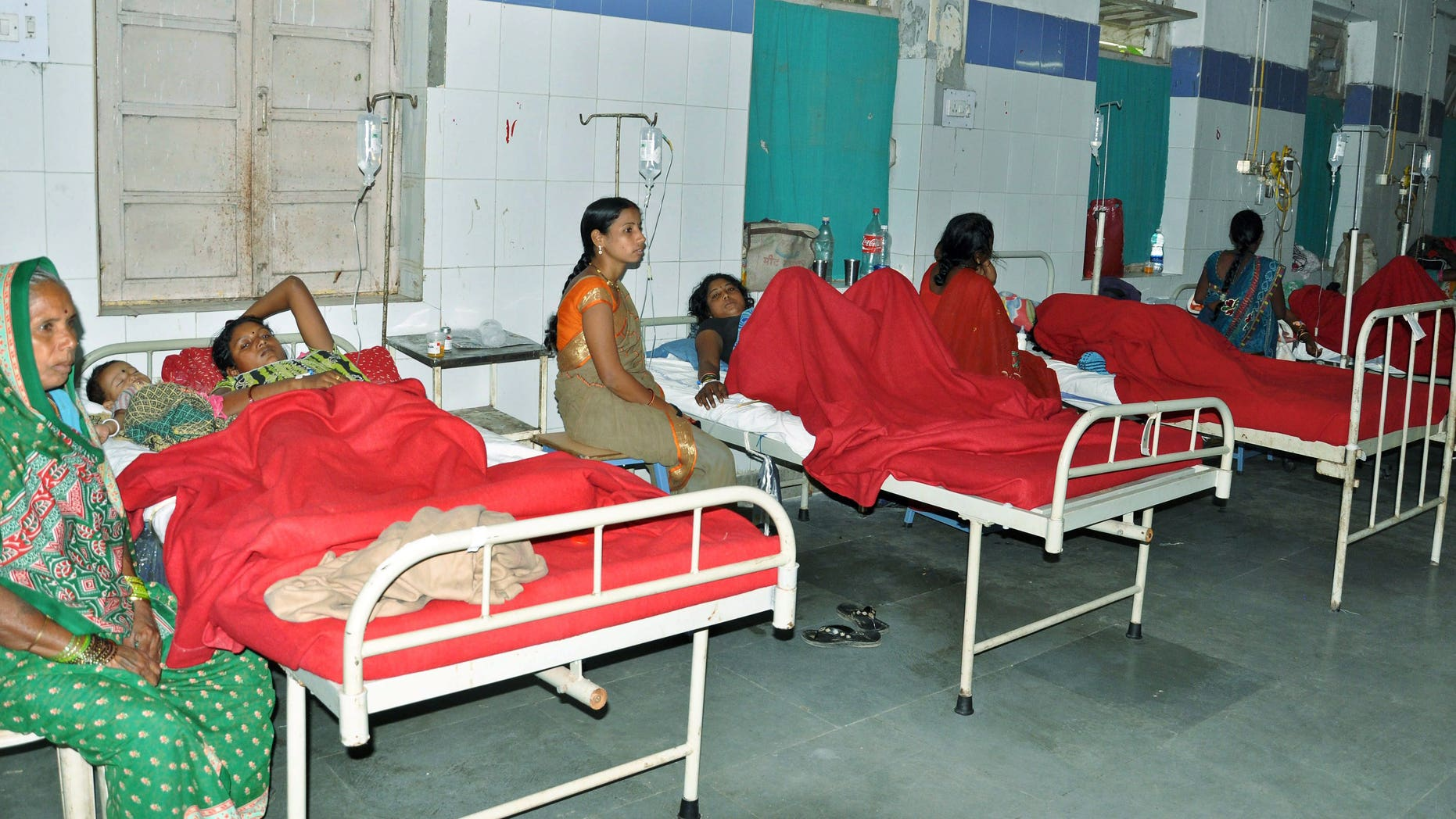 Indian women who underwent sterilization surgeries receive treatment at the CIMS hospital in Bilaspur, in the central Indian state of Chhattisgarh, Tuesday, Nov. 11, 2014. (AP Photo/Press Trust of India)