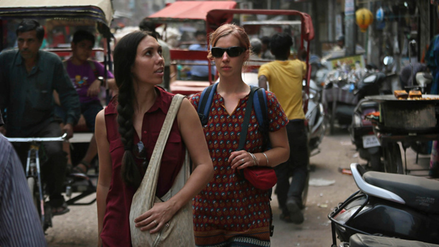 April 2, 2013: In this photo, foreign tourists walk on a street near the railway station in New Delhi, India. Violence against women, and the huge publicity generated by recent attacks here, is threatening India's $17.7 billion tourism industry. A new study shows tourism has plunged, especially among women, since a 23-year-old Indian student was raped on a New Delhi bus and later died from her injuries, a case that garnered worldwide publicity.