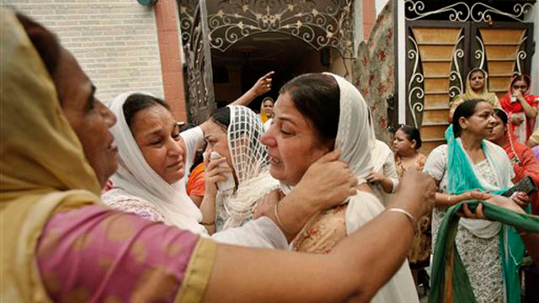 Relatives of blast victim Inder Singh mourn as his body is taken for cremation in New Delhi, India, Thursday, Sept. 8, 2011.