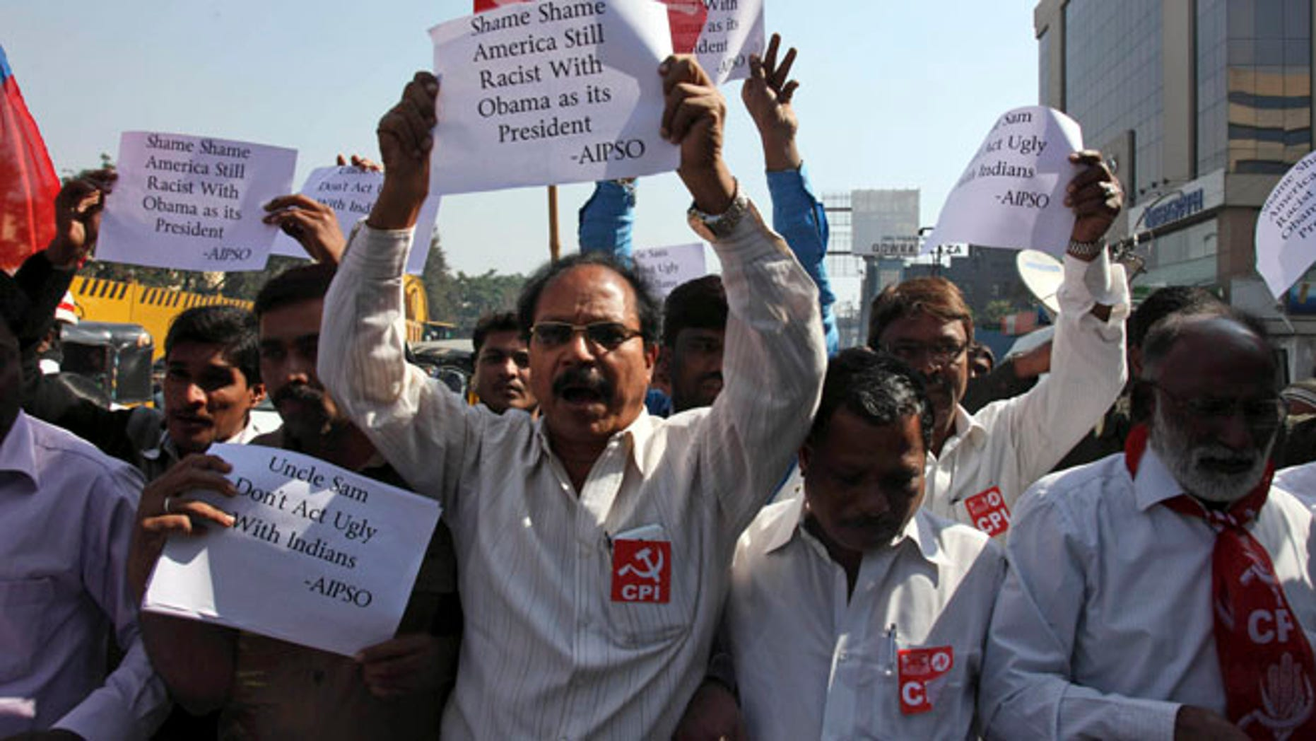 Dec. 19, 2013: Left Party activists hold placard and shout slogans during a protest against the alleged mistreatment of New York based Indian diplomat Devyani Khobragade, near the U.S Consulate in Hyderabad, India.