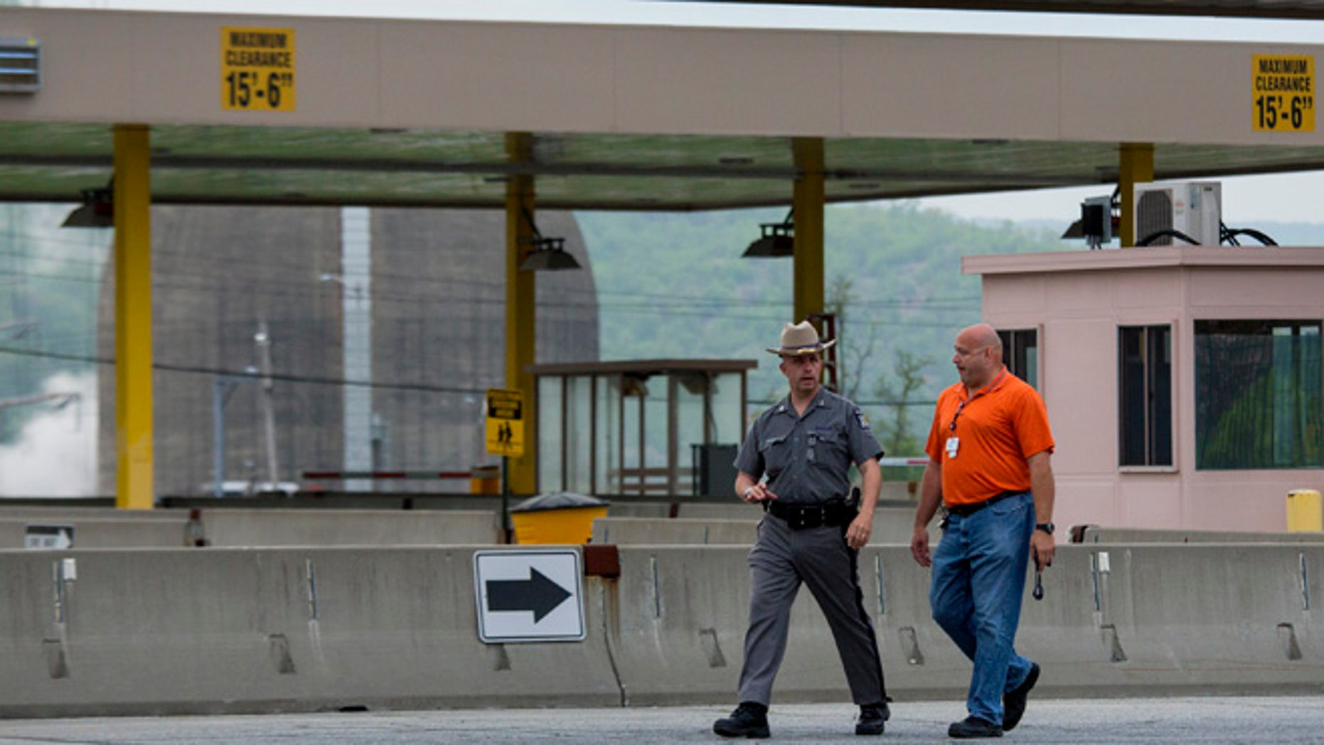 May 9, 2015: Police and security officials move about the Indian Point nuclear power plant after a transformer failed, causing a fire that has been extinguished in Buchanan, N.Y.