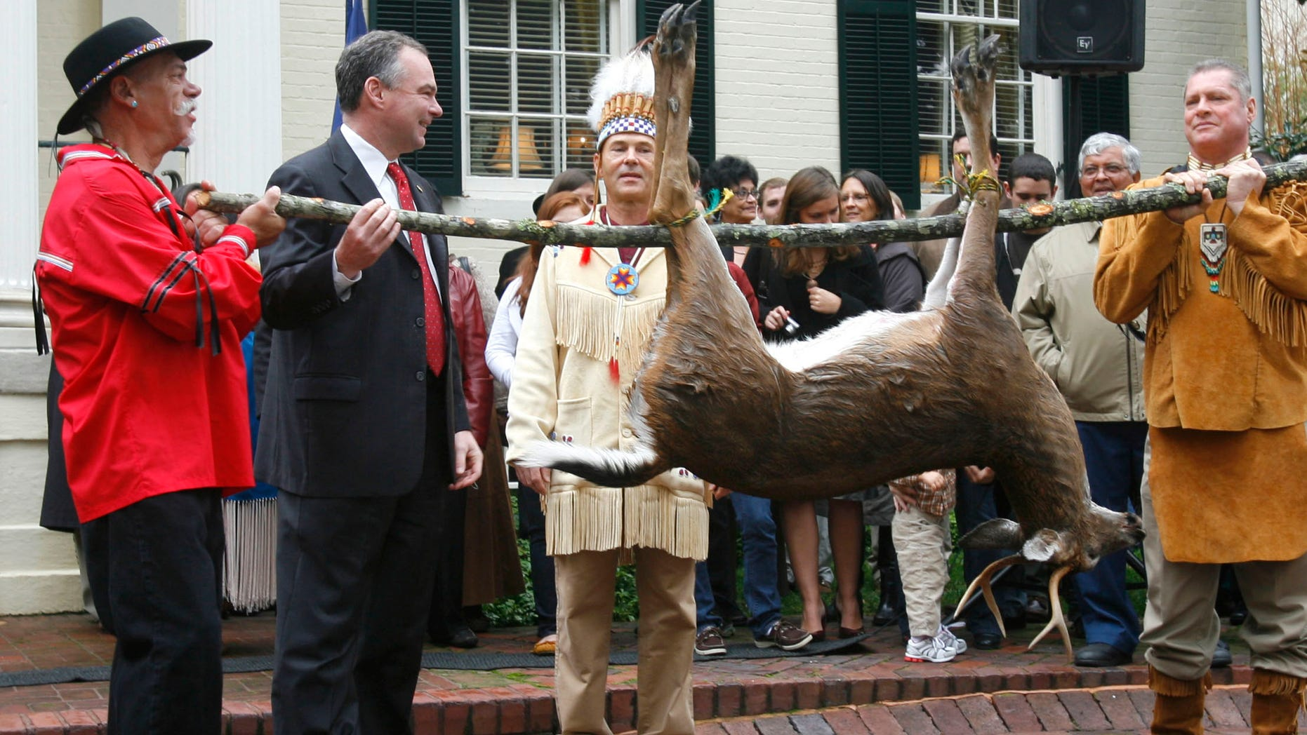 Nov. 25, 2009: Pamunkey Councilmen Jeff Brown, left, and Gary Miles, hold a deer as their Chief Kevin Brown presents it to Gov. Tim Kaine, second from left, during the annual tax tribute from the Virginia Indians to the Virginia governor. Several members of the Congressional Black Caucus are urging the Obama administration to withhold federal recognition of the Pamunkey tribe in southeast Virginia because of its history of banning intermarriage with blacks.