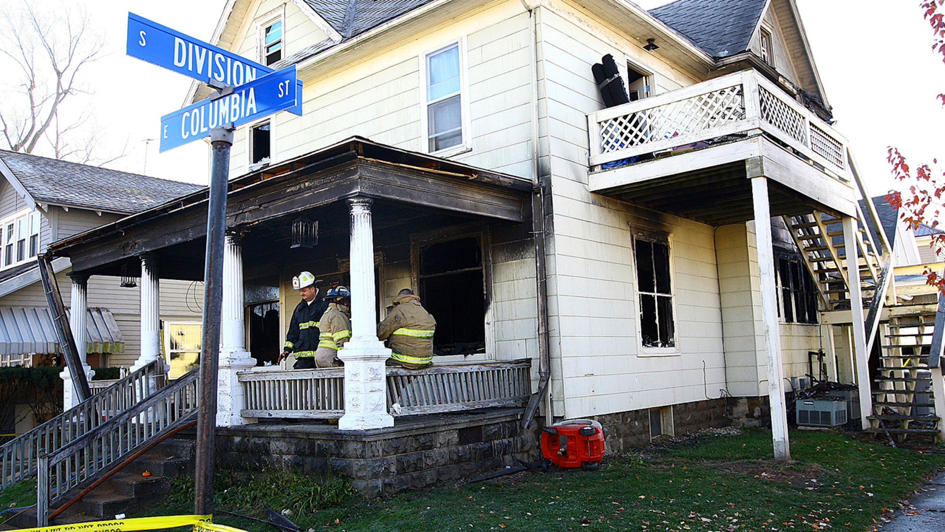 Firefighters work at a house where four children died in a house fire in the 100 block of East Columbia Street in Flora, Ind., on Monday morning, Nov. 21, 2016.