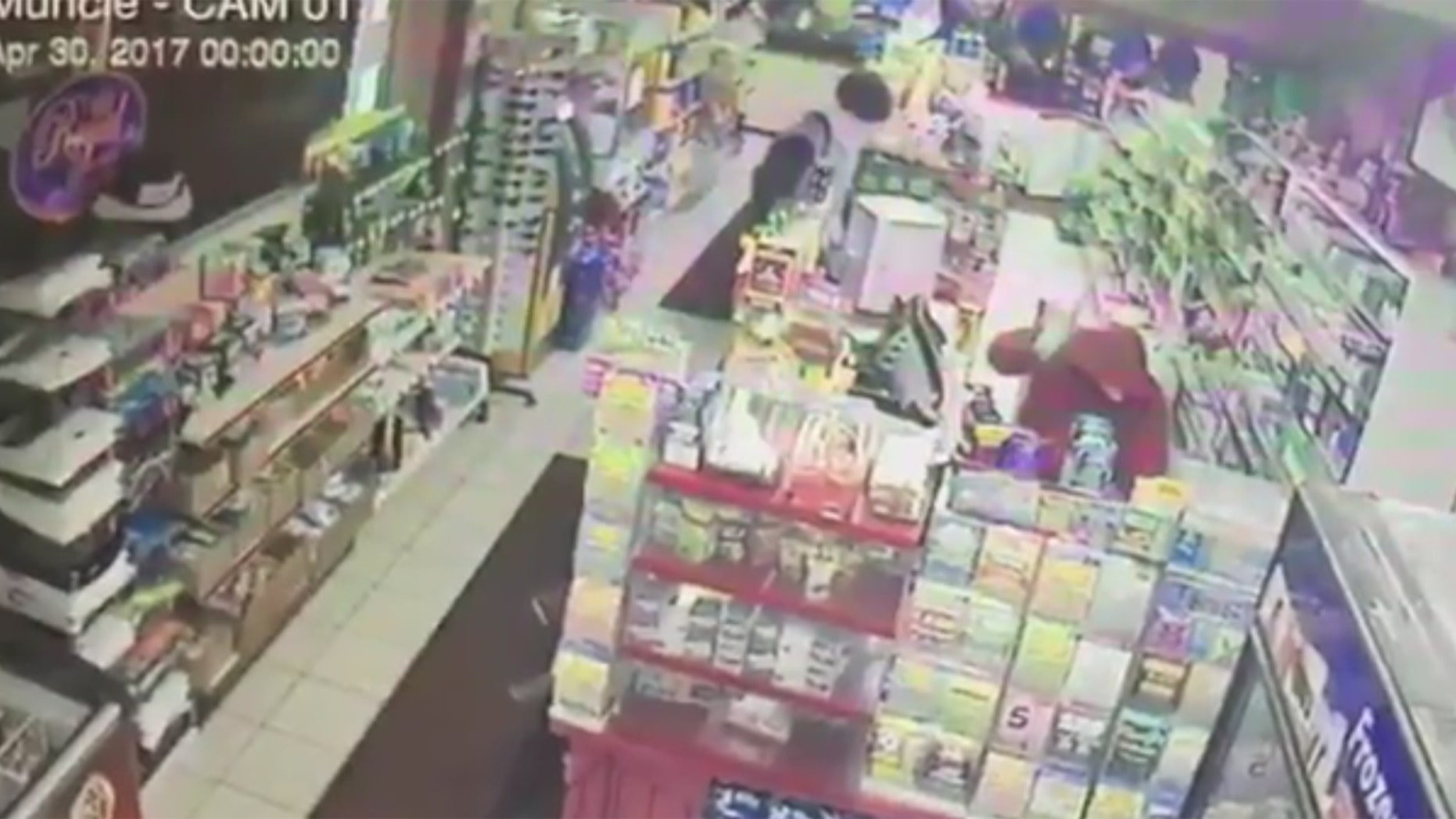 A suspect is seen beating a convenience store clerk in Muncie, Ind.