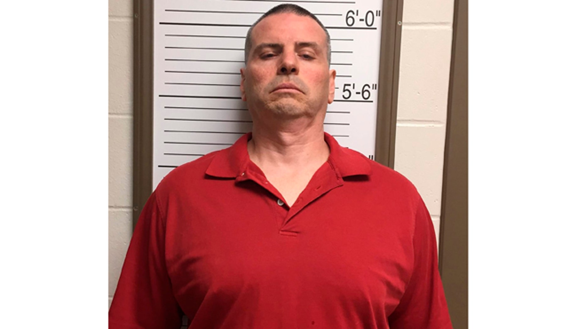 April 24, 2015: In this photo provided by the Brown County Sheriff's Dept. via the Bloomington Herald-Times Daniel Messel stands against a height board for a booking photo at the Brown County Jail in Nashville, Ind.
