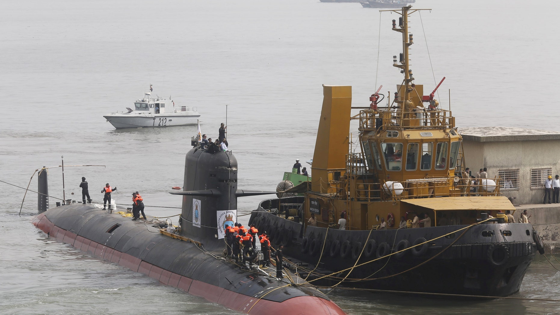 File photo of Indian Navy's Scorpene submarine INS Kalvari being escorted by tugboats as it arrives at Mazagon Docks Ltd, a naval vessel ship building yard, in Mumbai, India, Oct. 29, 2015. (REUTERS/Shailesh Andrade/Files)