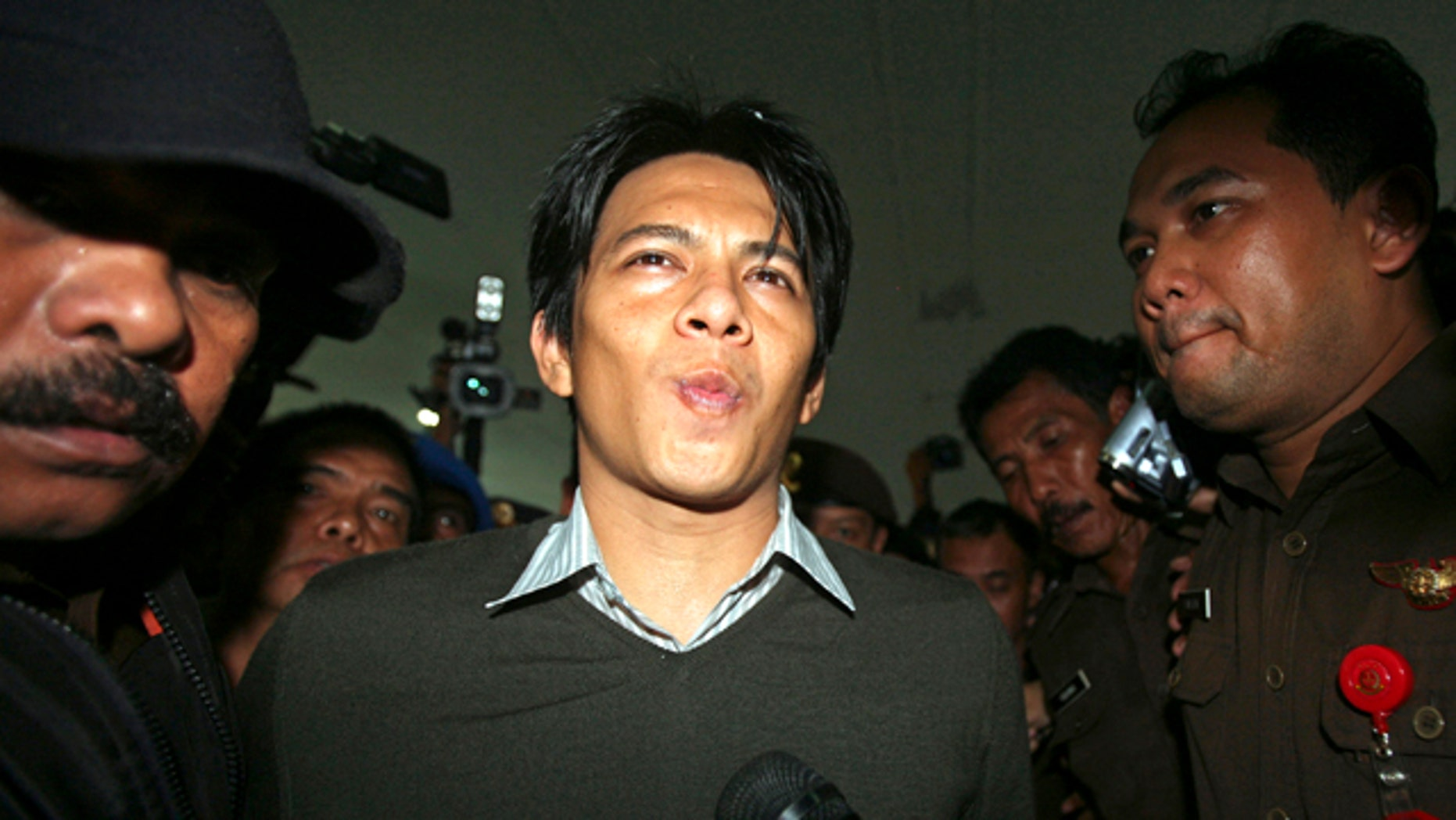 """Jan. 31: Indonesian singer Nazril """"Ariel"""" Irham of the group Peterpan pauses while talking to journalists after his trial at a district court in Bandung, West Java, Indonesia. The Indonesian pop star who rocked this predominantly Muslim nation after several homemade sex tapes found their way to the Internet was sentenced Monday to three and a half years in jail. (AP)"""