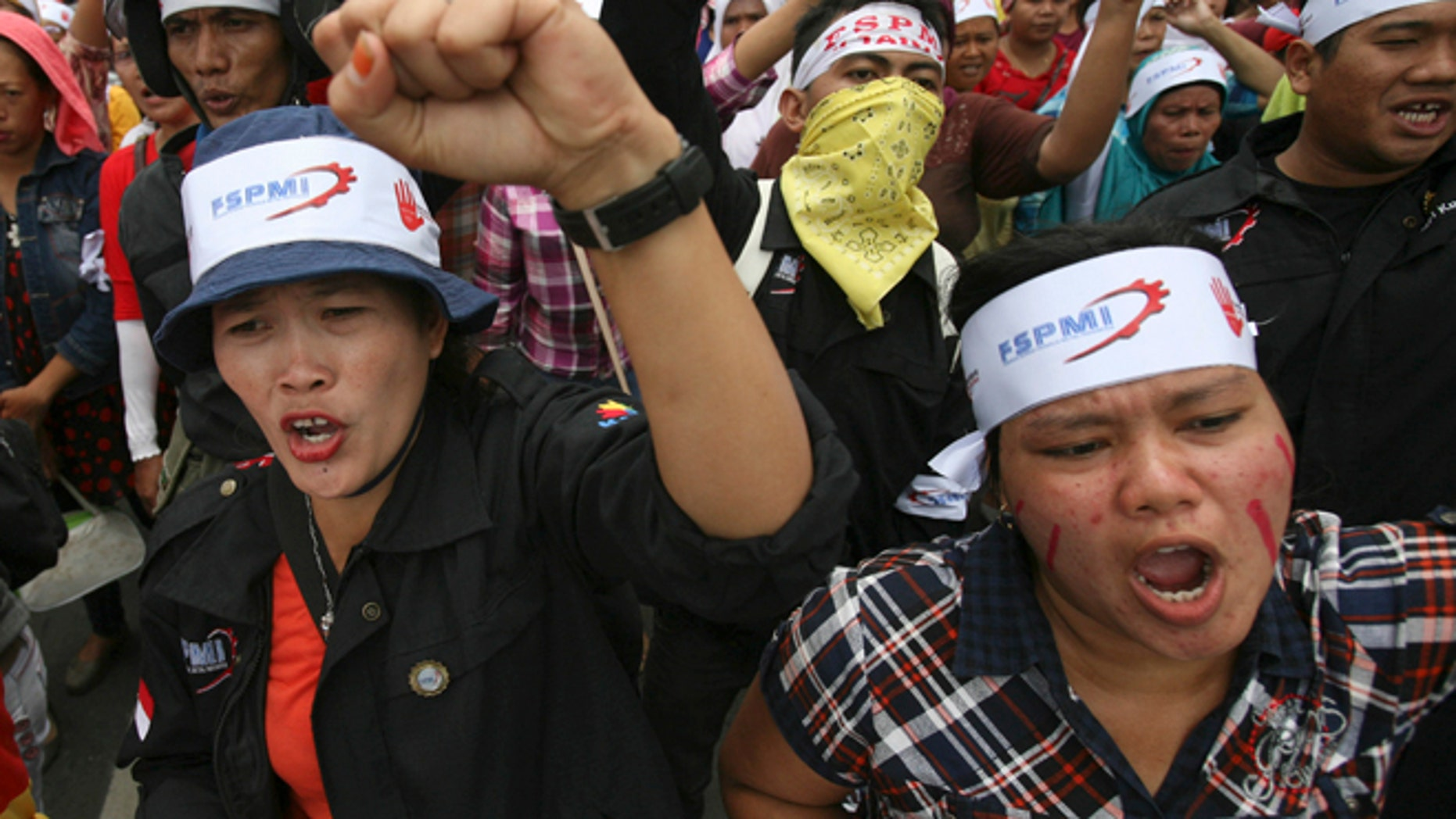 Oct. 3, 2012: Factory workers shout slogans during a protest in medan, North Sumatra, Indonesia.
