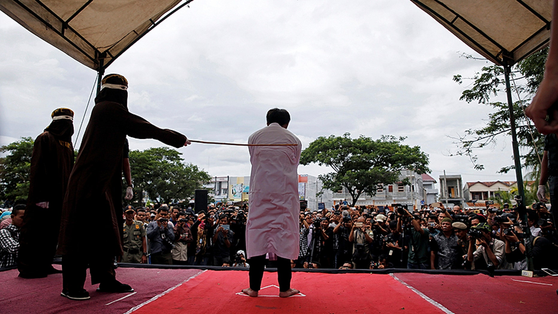 Two Christian Indonesians were caned for gambling, which is against sharia law.