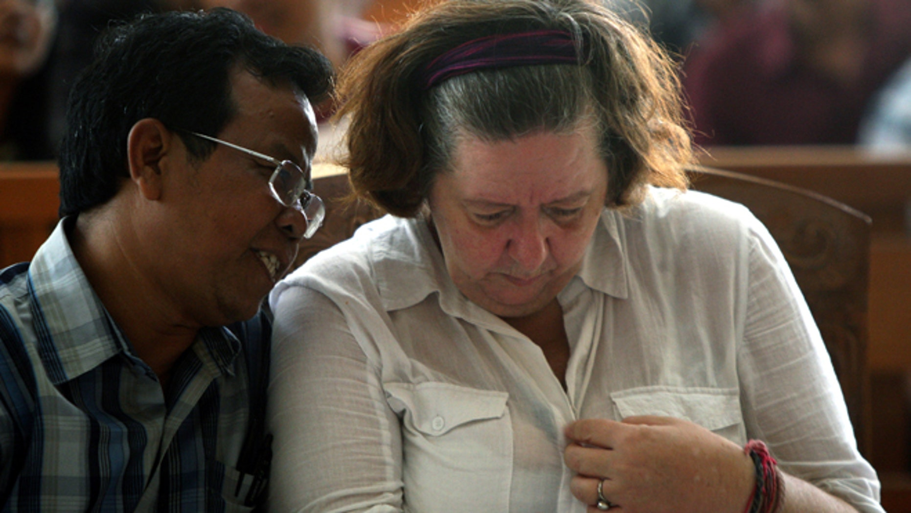 Jan. 22, 2013: Lindsay June Sandiford of Britain, right, listens to her interpreter during her sentencing at a courthouse, in Denpasar, Bali island, Indonesia.
