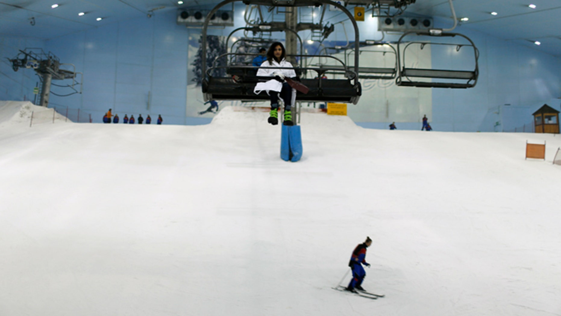 Visitors ski and ride in chairlifts in Dubai's indoor mountain-themed ski park, at Emirates mall in Dubai September 25, 2013.