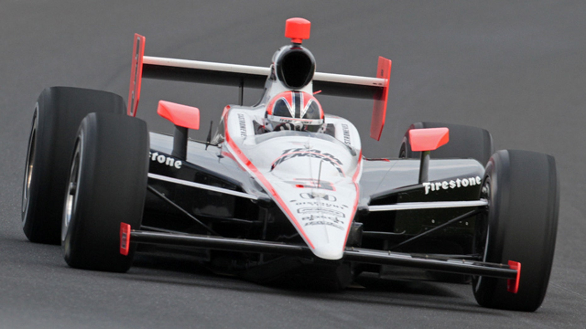 Helio Castroneves makes a qualifying run at the Indianapolis Motor Speedway