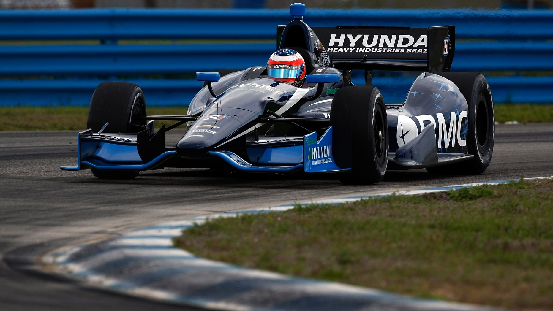 SEBRING, FL - MARCH 08:  Rubens Barichello of Brazil drives his #8 BMC KV Racing Technolgy Chevy Dallara DW12 during the Sebring Open Test for the IZOD INDYCAR Series at Sebring International Raceway on March 8, 2012 in Sebring, Florida.  (Photo by Jonathan Ferrey/Getty Images)
