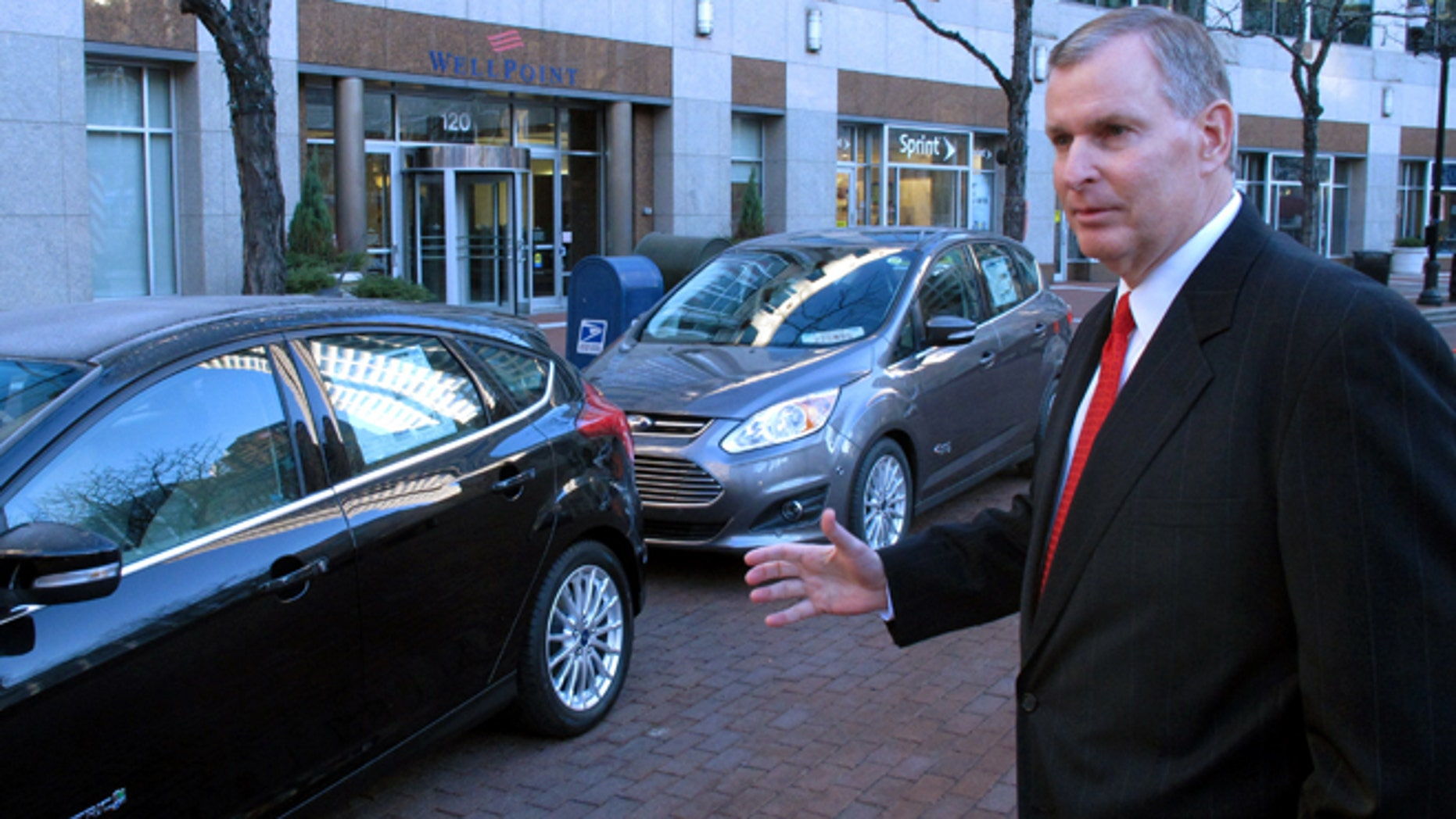 Indianapolis Mayor Greg Ballard talks about replacing it's fleet of cars with electric and plug-in hybrids like these shown following an announcement in Indianapolis, Wednesday, Dec. 12, 2012. Indianapolis plans to replace its entire fleet with electric and plug-in hybrid vehicles by 2025.  (AP Photo/Rick Callahan)