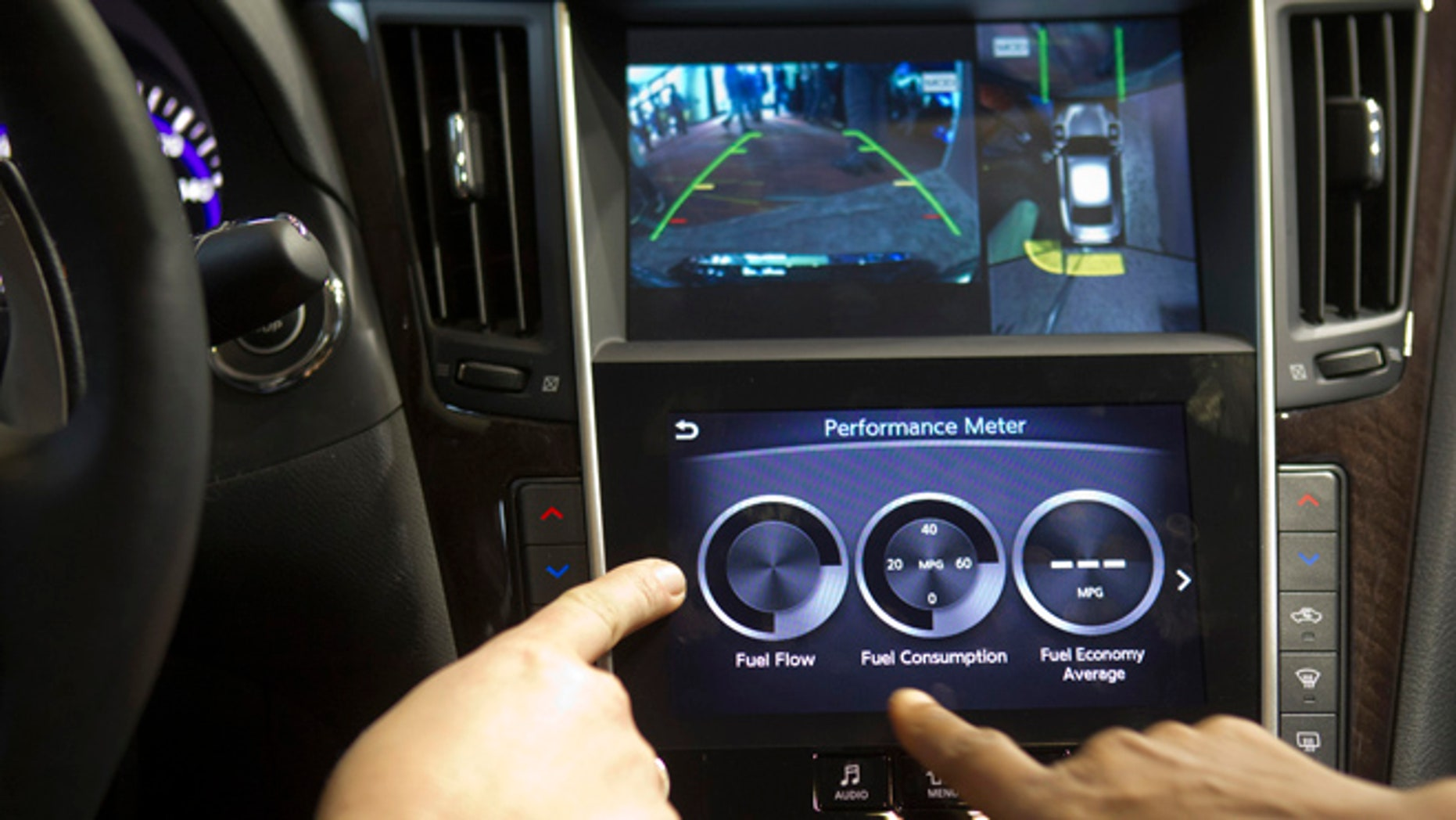 An Infiniti InTouch infotainment system is demonstrated inside an Infinity Q50S during the 2014 International Consumer Electronics Show (CES) in Las Vegas, Nevada.
