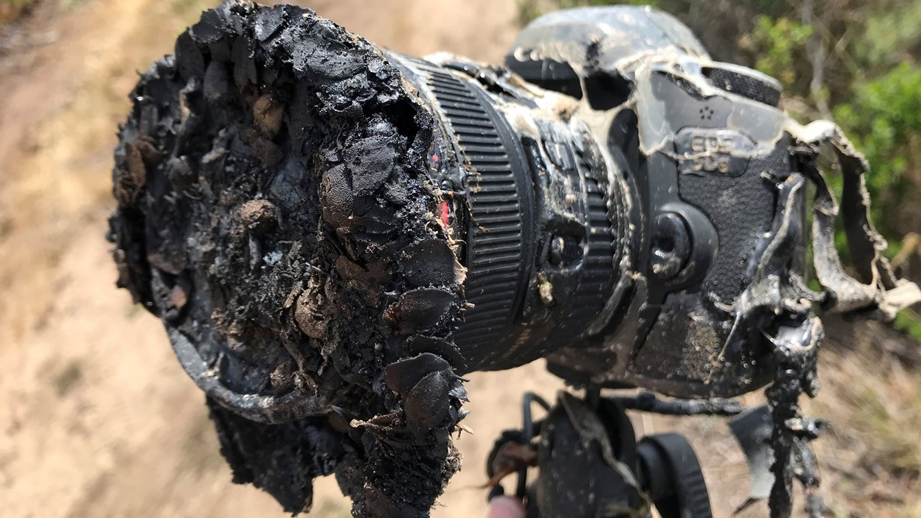 A NASA camera melted after it was engulfed in flames from a brush fire.