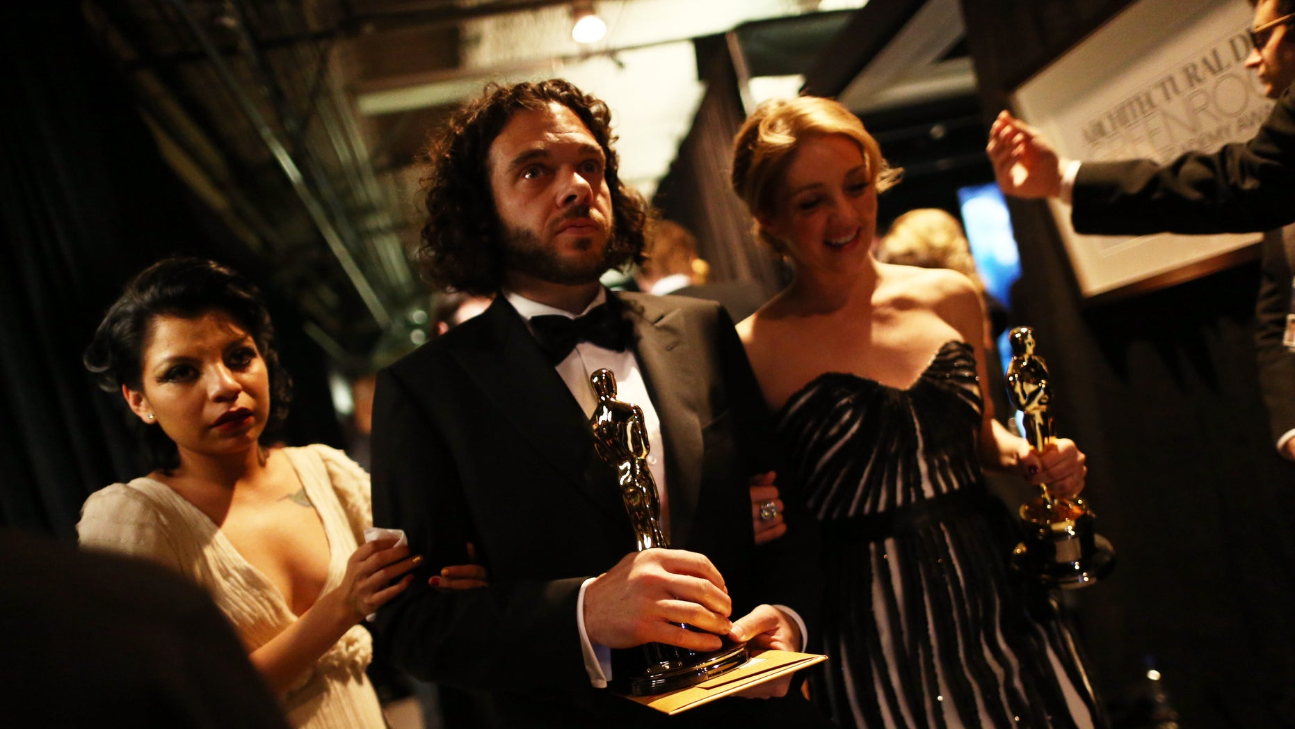 HOLLYWOOD, CA - FEBRUARY 24:  (L-R) Artist Inocente Izucar, filmmakers Sean Fine and Andrea Nix Fine, winners of the Best Documentary Short Subject award for 'Inocente,' backstage during the Oscars held at the Dolby Theatre on February 24, 2013 in Hollywood, California.  (Photo by Christopher Polk/Getty Images)