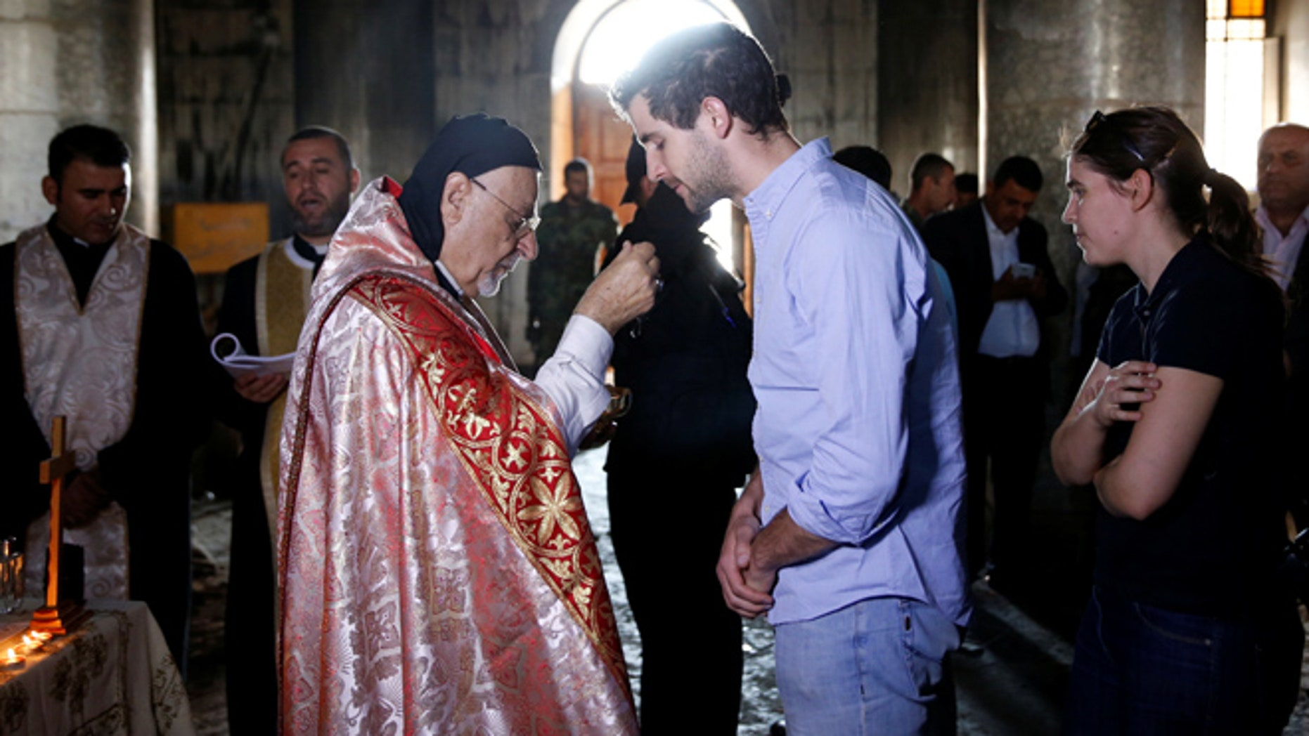 OCT 30: Iraqi priests hold the first Sunday mass at the Grand Immaculate Church since it was recaptured from Islamic State in Qaraqosh.