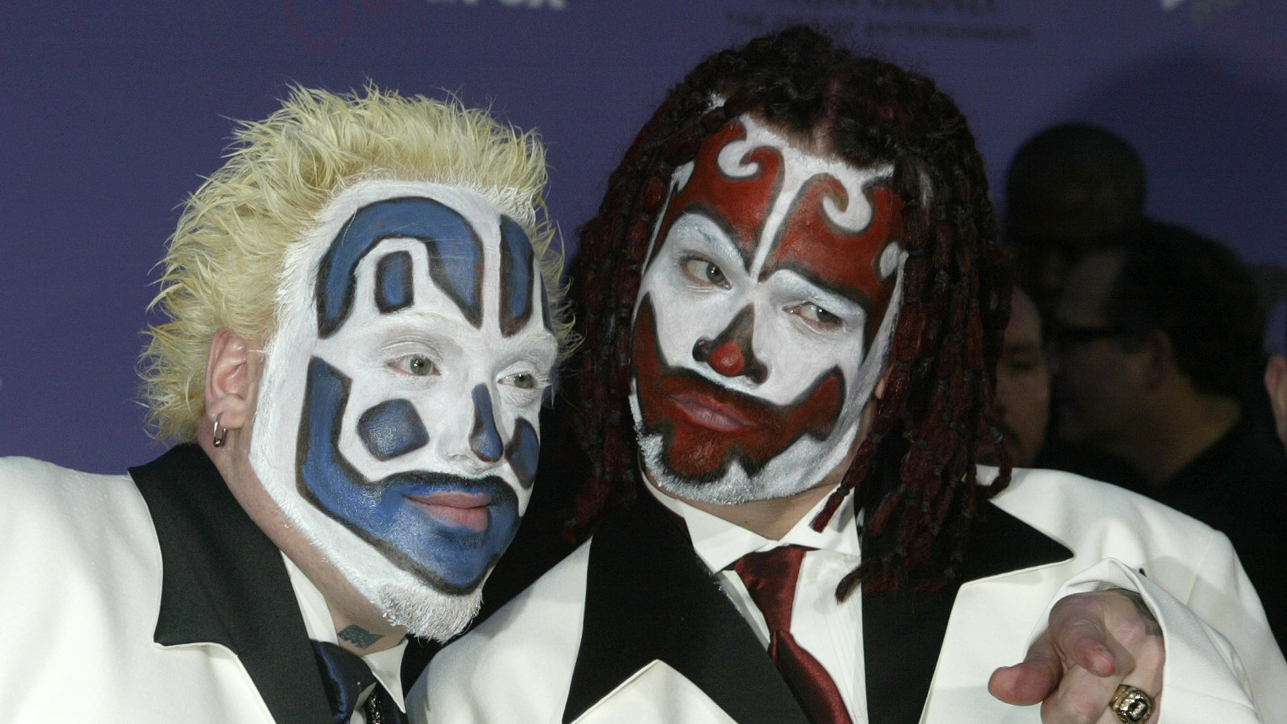 Members of the Insane Clown Posse pose as they arrive at the 2003 Billboard Music Awards at the MGM Grand Garden Arena in Las Vegas, Nevada, Dec. 10, 2003.