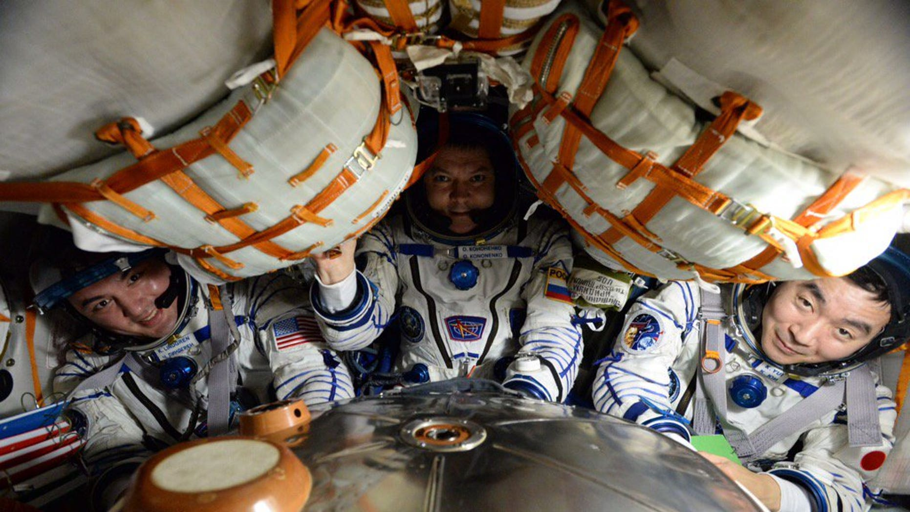 Expedition 45 crew members Kjell Lindgren of NASA, Oleg Kononenko of the Russian Federal Space Agency and Kimiya Yui of the Japan Aerospace Exploration Agency settle into the Soyuz TMA-17M spacecraft that carried them safely back to Earth on Dec. 11, 2015 after their 141-day mission aboard the International Space Station. (NASA)