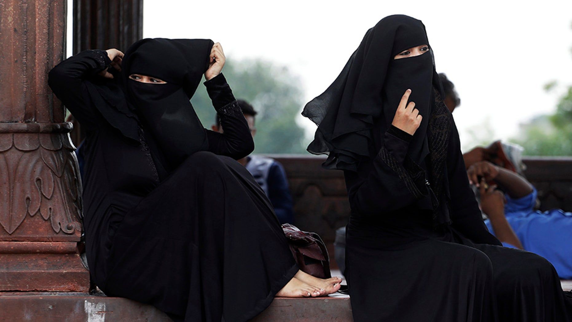 Indian Muslim women rest inside Jama Masjid mosque in New Delhi, India. India's government has approved an ordinance to implement a top court ruling striking down the Muslim practice that allows men to instantly divorce.