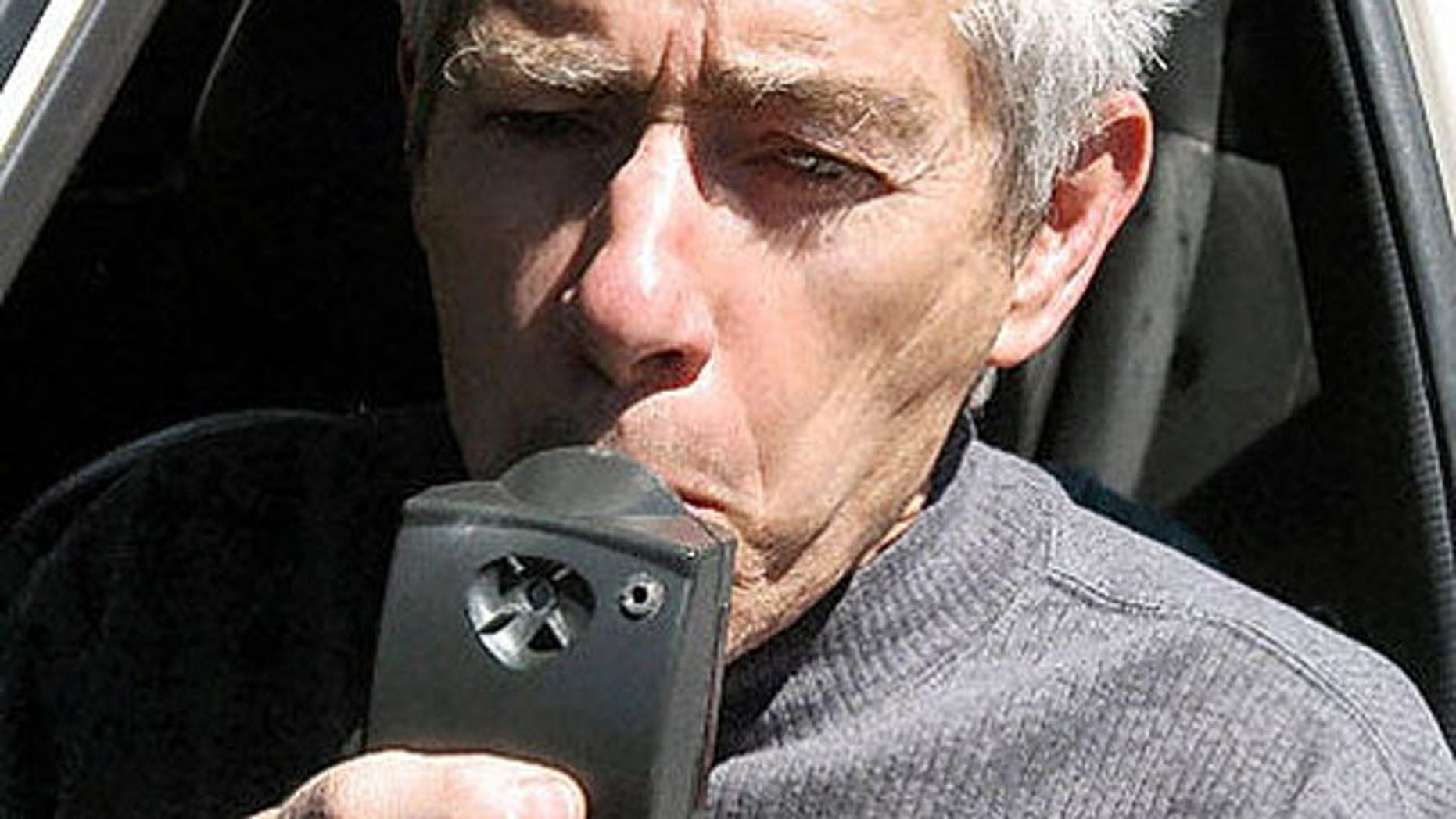 Richard Roth, a lobbyist for the ignition interlock device for drunk drivers, demonstrates the device in Santa Fe, N.M., in 2005. New Mexico saw a significant drop in repeat DWI offfenders after introducing the device.