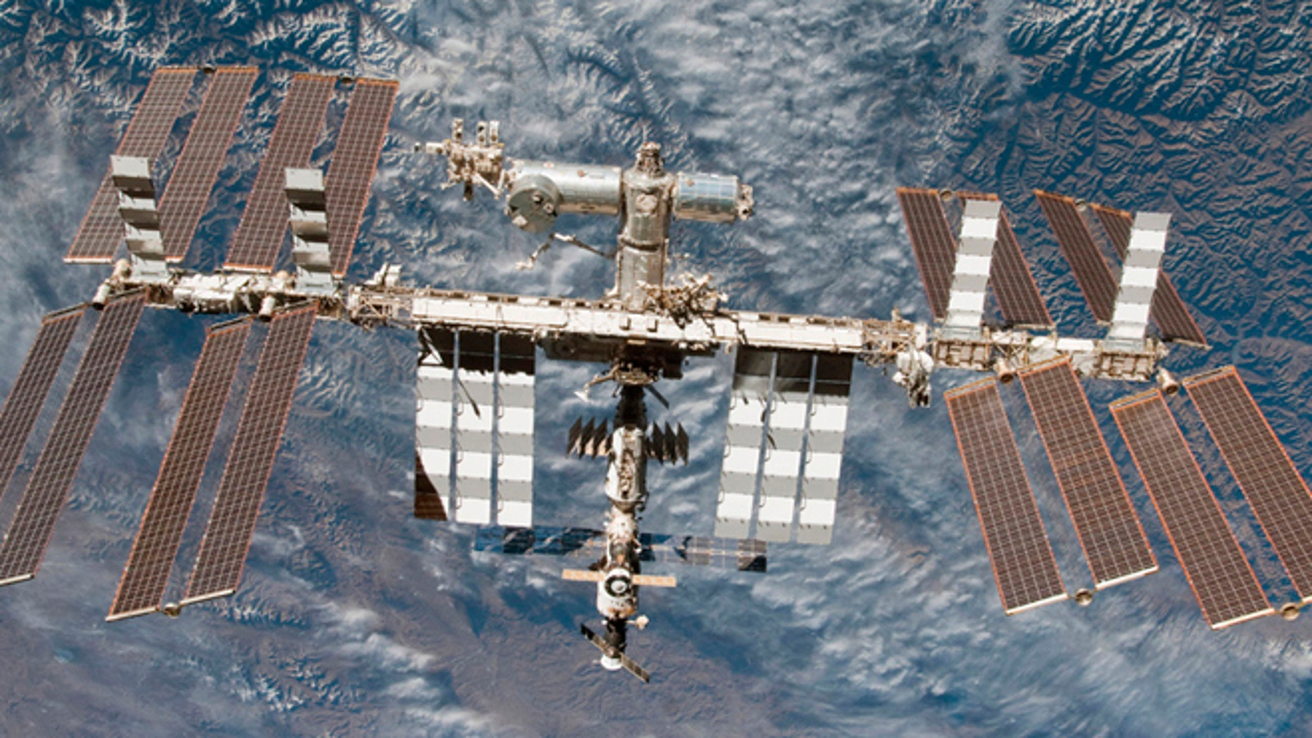 Backdropped by Earth, the International Space Station is seen in this image photographed by an STS-130 crew member on space shuttle Endeavour after the station and shuttle began their post-undocking relative separation, in this undated NASA handout photo.