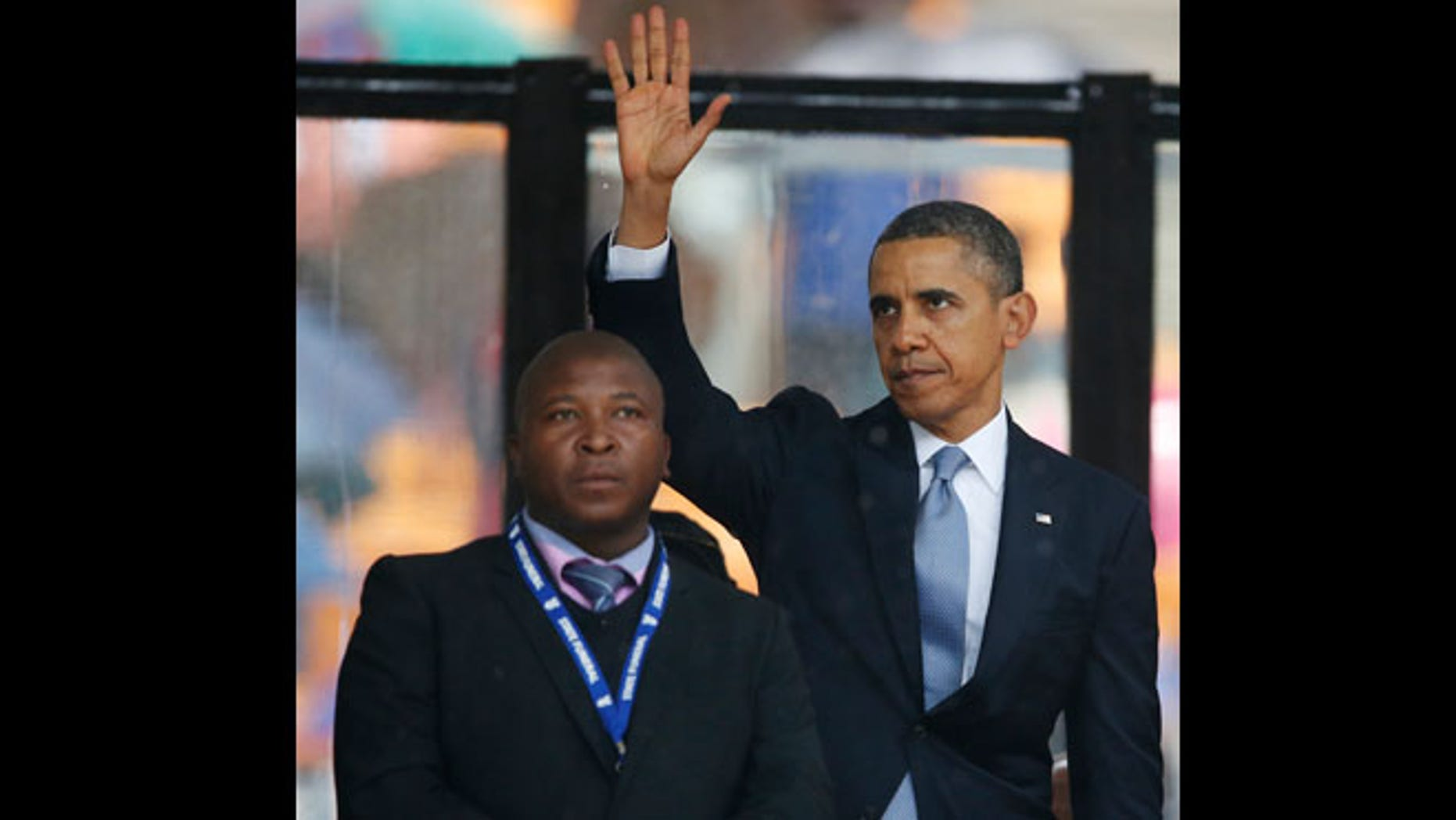 Dec. 10, 2013: President Barack Obama waves standing next to the sign language interpreter after making his speech at the memorial service for former South African president Nelson Mandela at the FNB Stadium in Soweto near Johannesburg. South Africa's deaf federation said on Wednesday that the interpreter on stage for Mandela memorial was a 'fake.'
