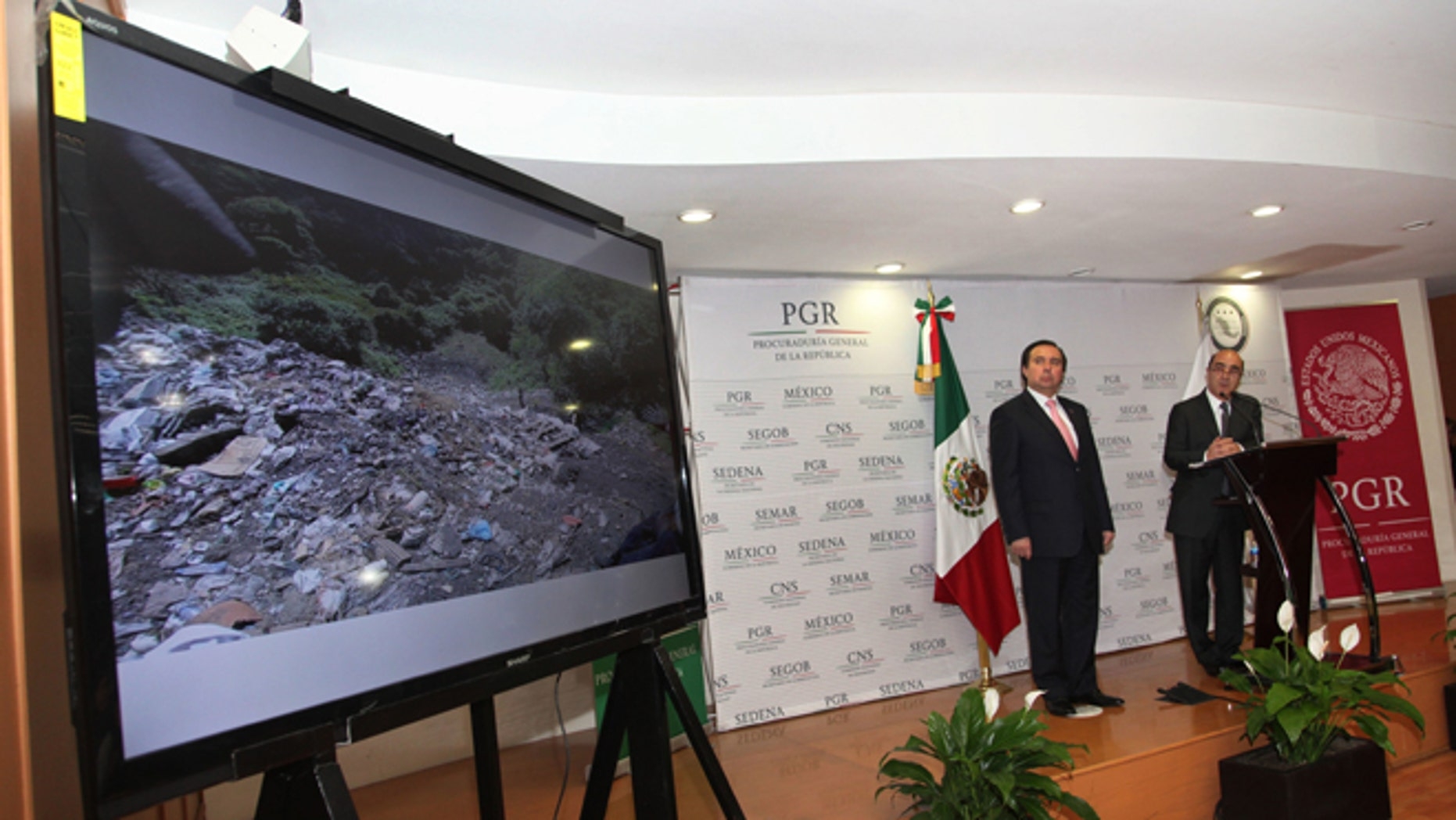 FILE - In this Dec. 7, 2014, file photo, Mexico's Attorney General, Jesus Murillo Karam, right, flanked by Tomas Zeron director of Mexico's Criminal Investigation Agency, speaks during a news conference in Mexico City. The Attorney Generalââ¬â¢s Office has announced on Wednesday, Sept. 14, 2016, the resignation of Tomas Zeron, whose dismissal had been demanded by the families of 43 college students who disappeared two years ago. (AP Photo/Marco Ugarte, File)