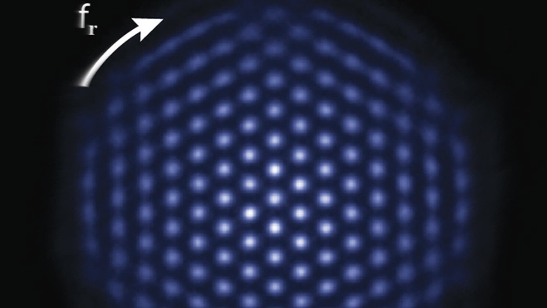 The NIST simulator consists of a tiny, single-plane crystal of hundreds of beryllium ions, less than 1 millimeter in diameter, hovering inside a device called a Penning trap. Here, the ions are glowing, indicating that they are all in the same quantum state. Under the right experimental conditions, the ion crystal spontaneously forms this nearly perfect triangular lattice structure.