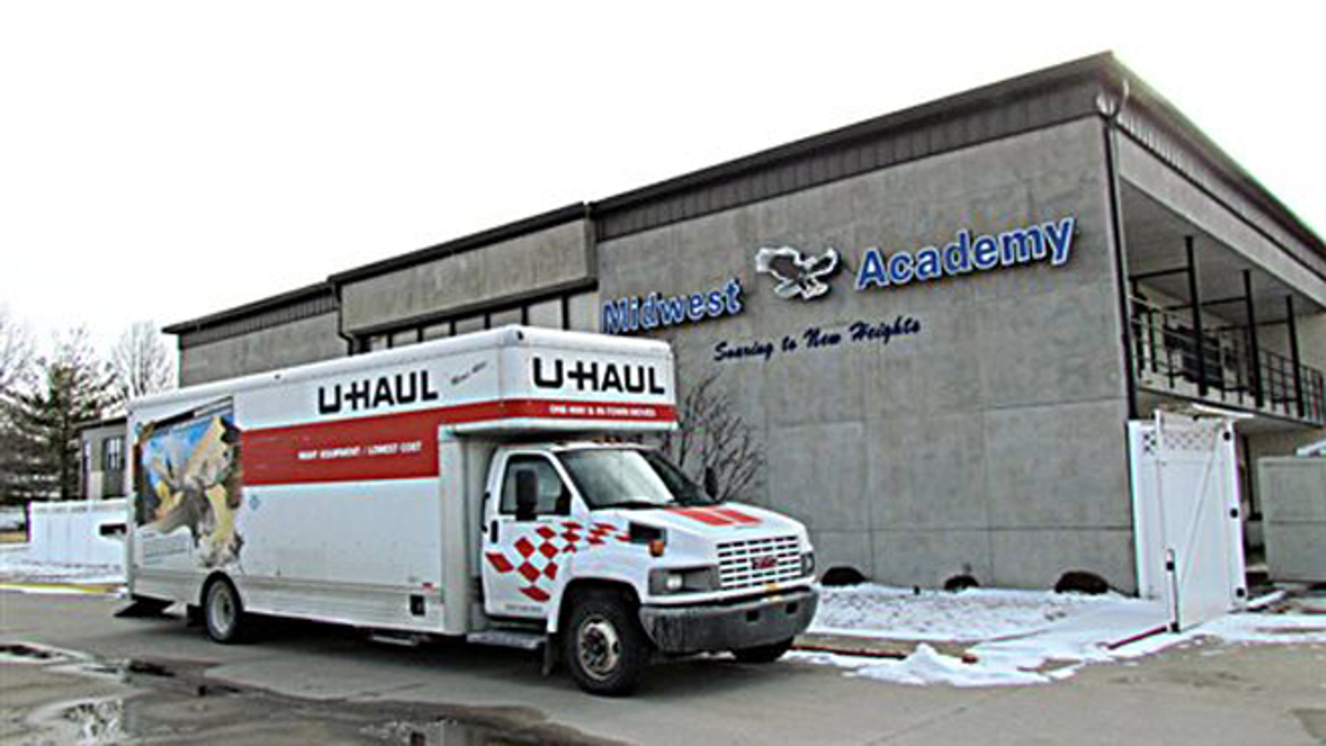 Photo taken Thursday, Feb. 11, 2016, shows a U-Haul outside Midwest Academy in Keokuk, Iowa. (Cindy Iutzi/Daily Gate City via AP)