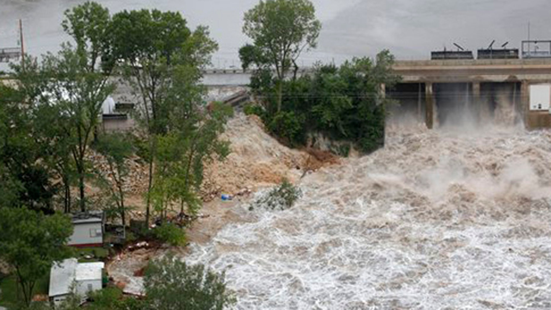July 24, 2010: Maquoketa River water gushes out of the Delhi Dam as areas surrounding the Maquoketa River continue to flood.