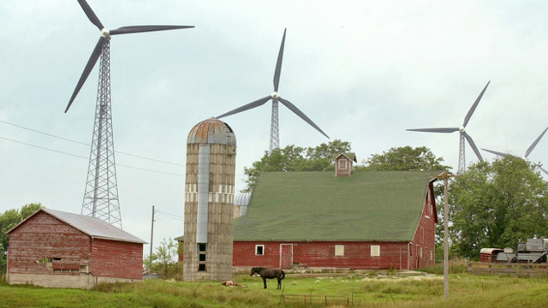 FILE: July 24, 2001: Wind turbines are shown on farmland in Alta, Iowa. An Iowa woman was charged March 3, 2014, in the 1983 killings of her estranged husband and his girlfriend at a horse ranch in Newton.