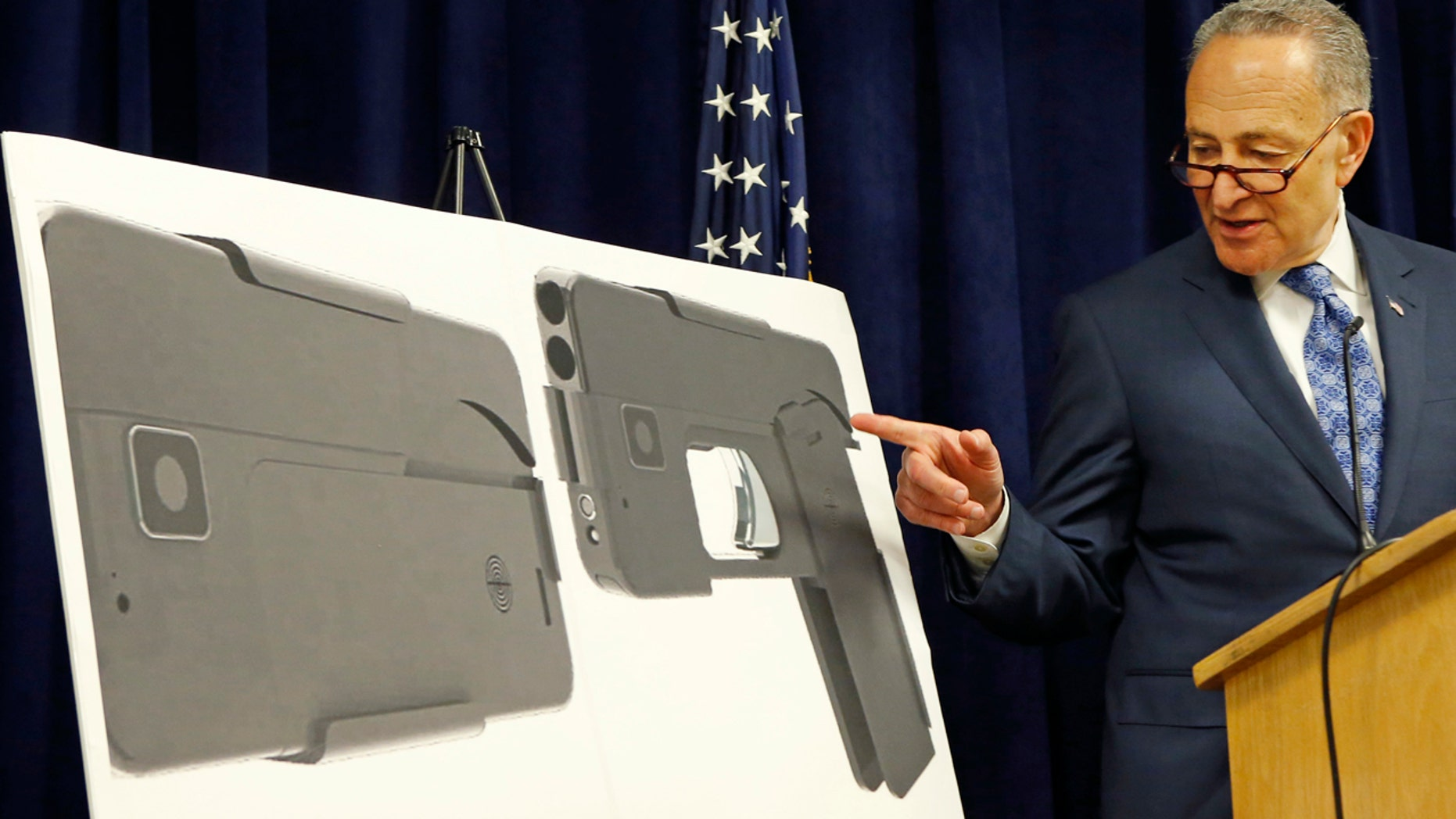 April 4, 2016: U.S. Sen Charles Schumer, (D-New York), points to photographs of what appears to be a cell phone, but is actually a handgun, during a press conference in his office