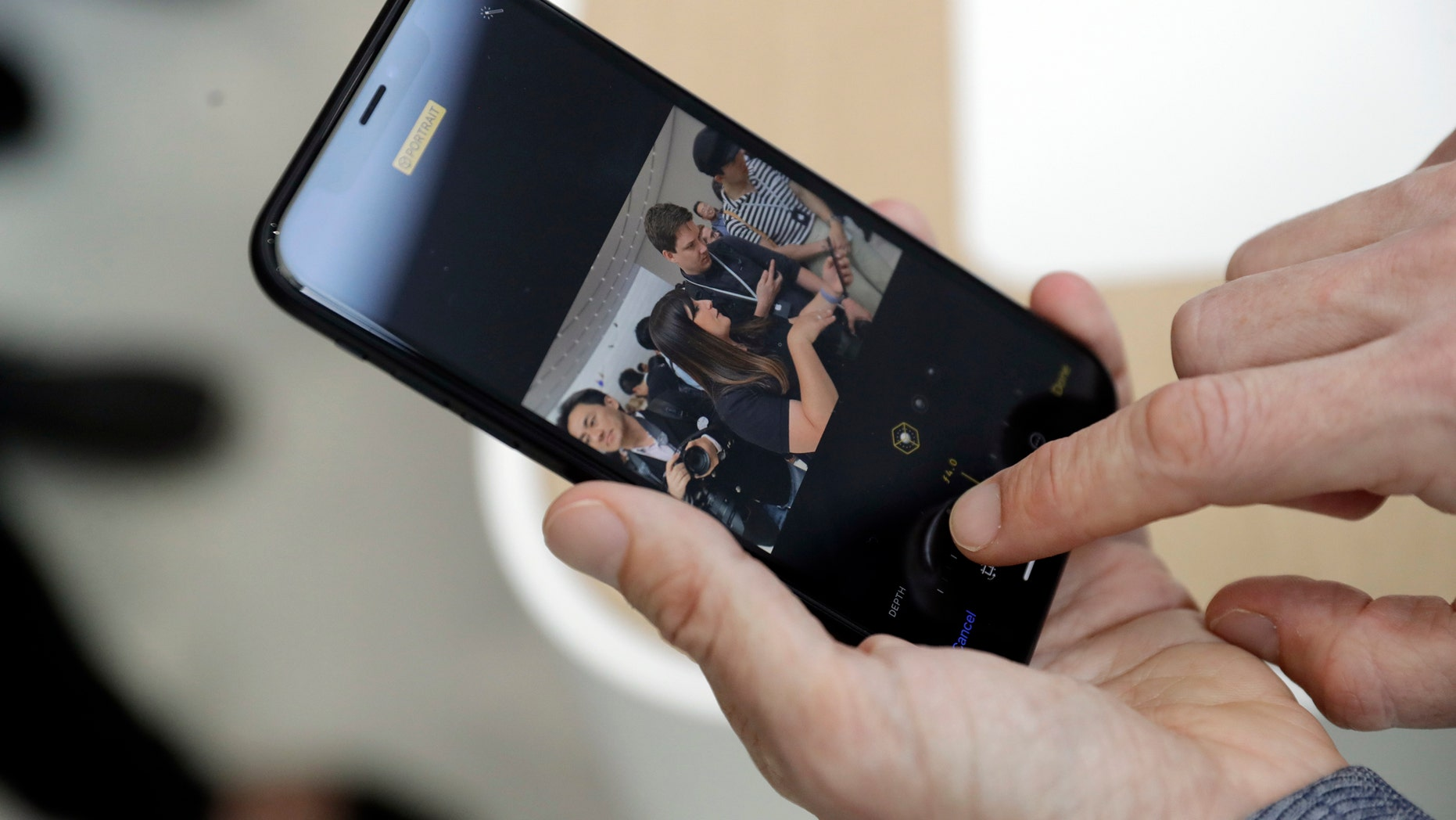 The new picture controls features are shown on an iPhone XR during an event to announce new products Wednesday, Sept. 12, 2018, in Cupertino, Calif. (AP Photo/Marcio Jose Sanchez)