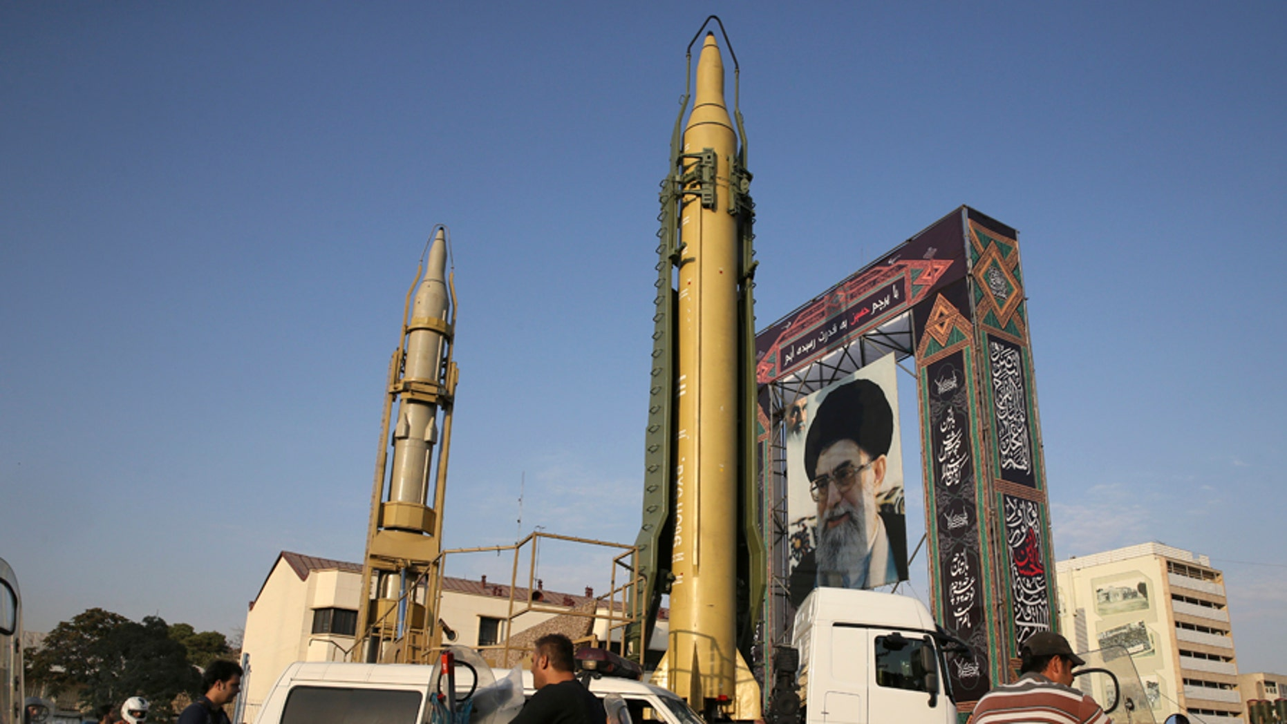 A Ghadr-H missile, center, a Sejjil missile and a portrait of the Iranian Supreme Leader Ayatollah Ali Khamenei are on display for the annual Defense Week, marking the 37th anniversary of the 1980s Iran-Iraq war, at Baharestan Sq. in Tehran, Iran, Sunday, Sept. 24, 2017