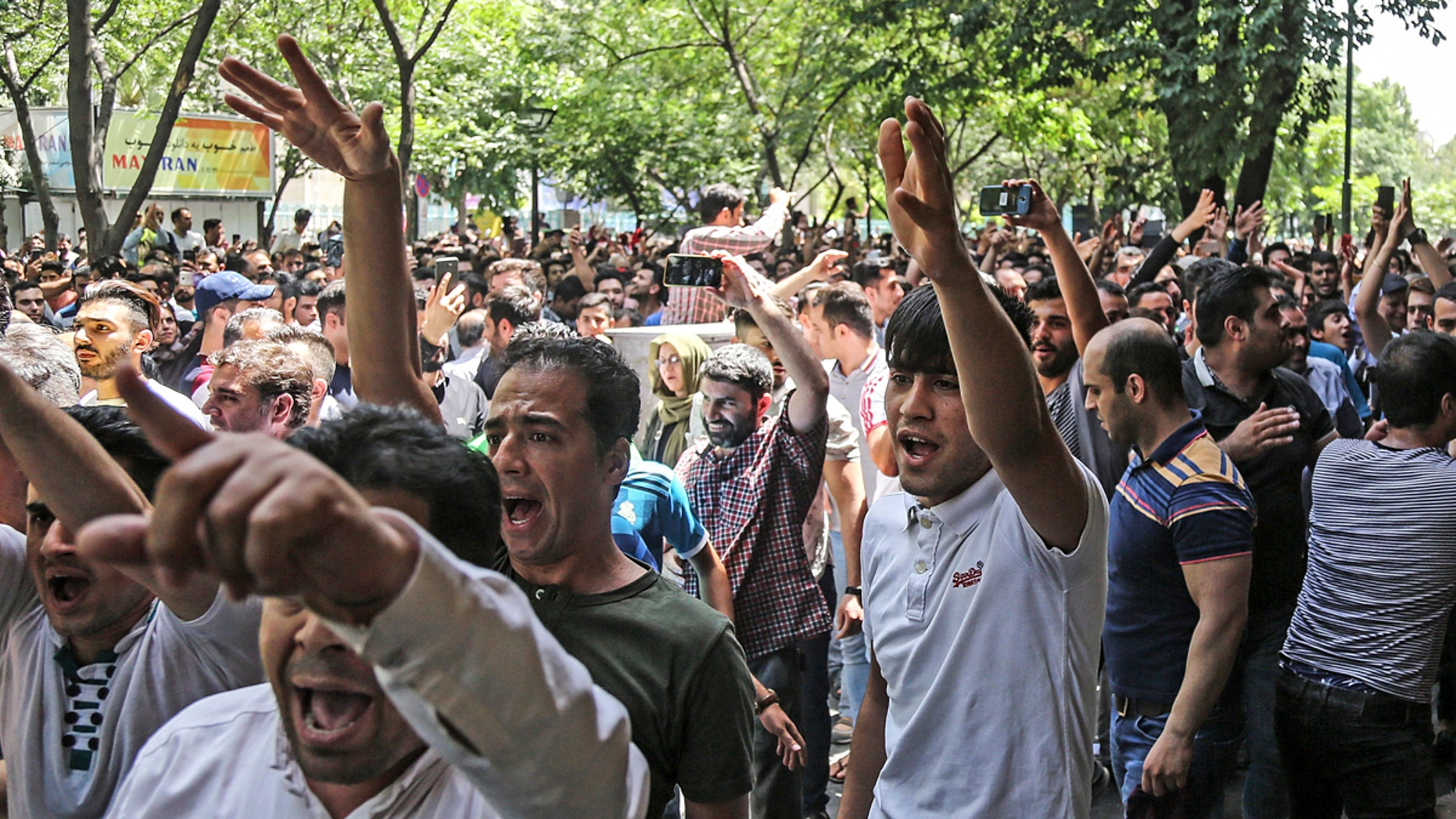 A group of protesters chant slogans at the old grand bazaar in Tehran, Iran, Monday, June 25, 2018.