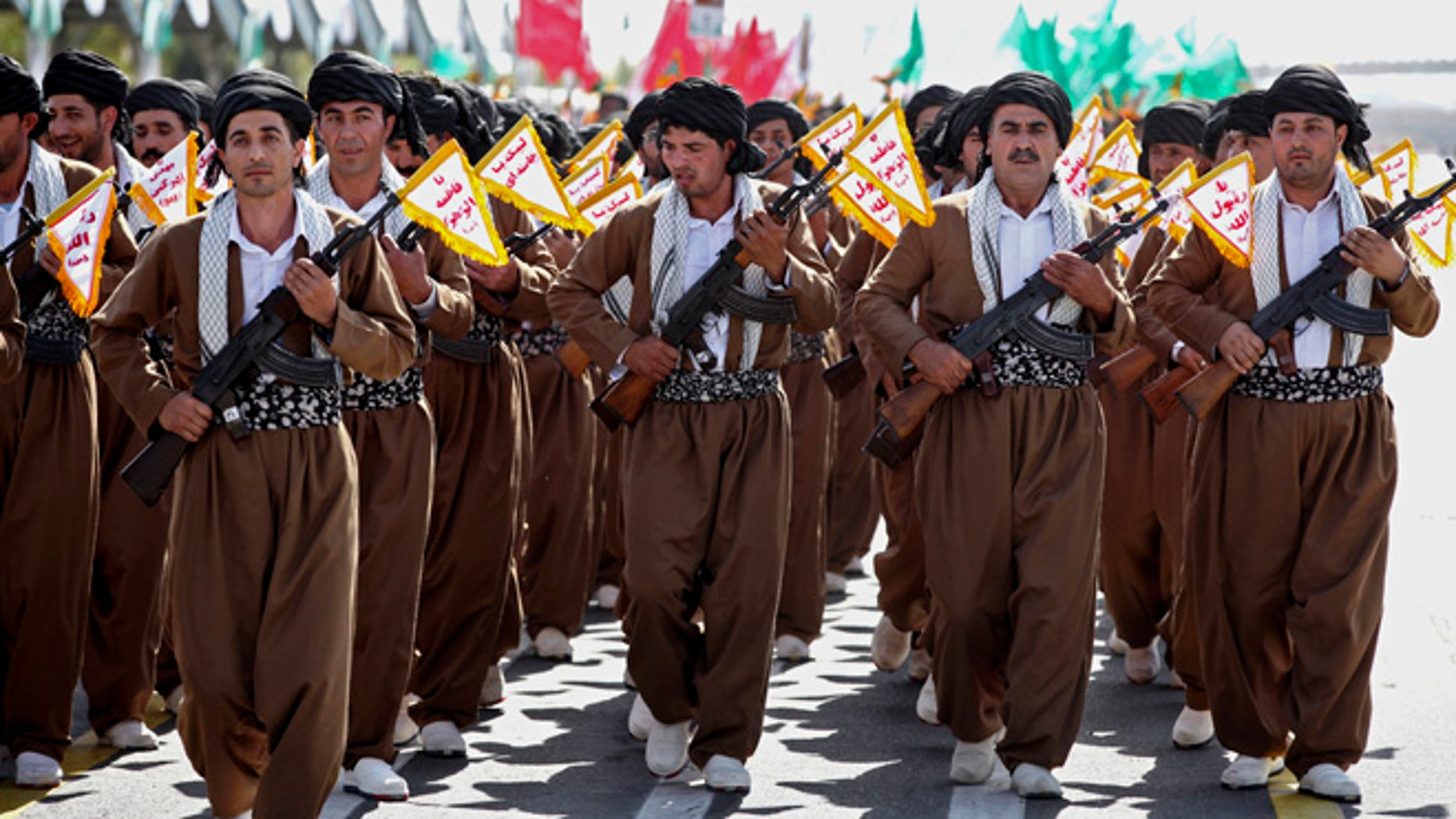 Sept, 22, 2013: Kurd volunteer members of Basij, the Revolutionary Guards paramilitary branch, march during an annual military parade in Tehran, Iran.