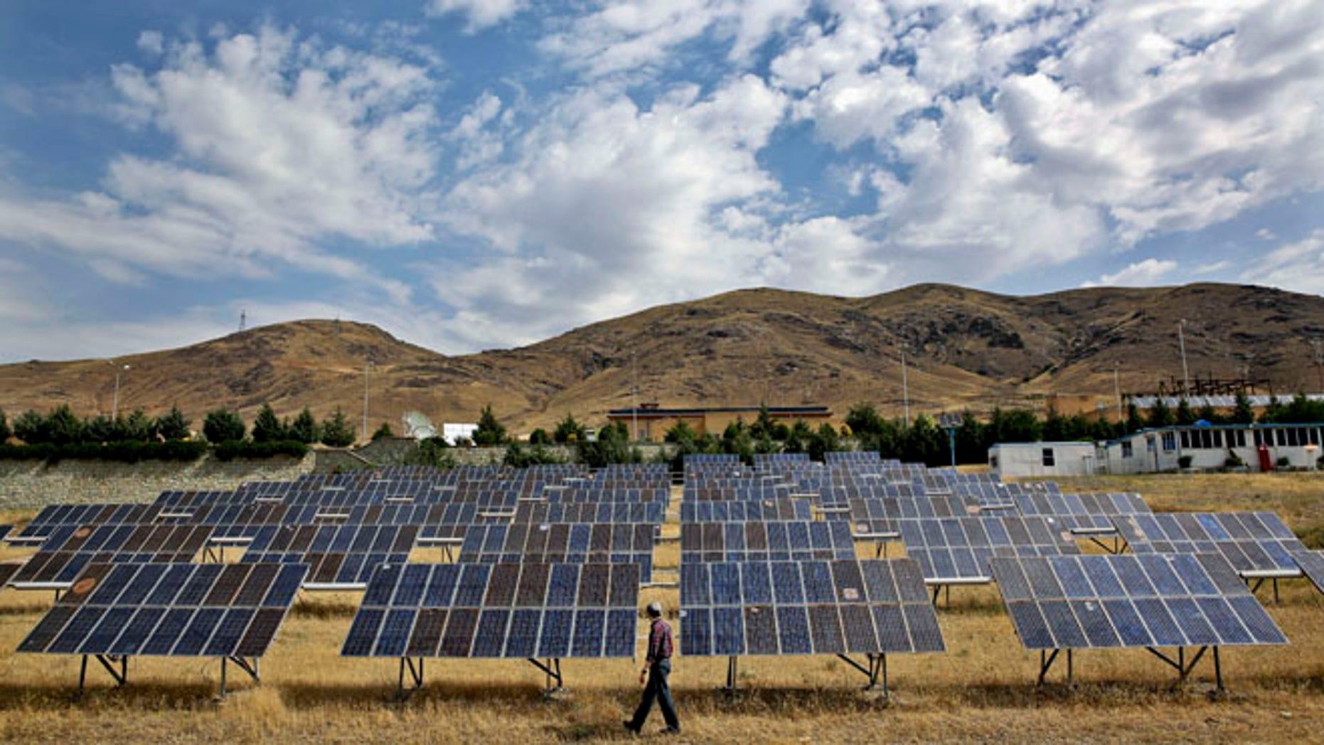 June 22, 2014: A man looks at solar panels at the Taleghan Renewable Energy Site in Taleghan, 99 miles northwest of Tehran, Iran.