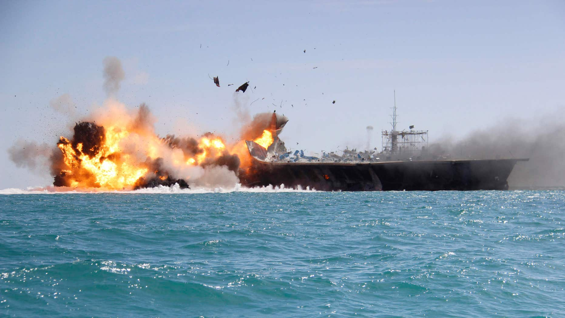 Feb. 25, 2015: A replica of a U.S. aircraft carrier is exploded by the Revolutionary Guard's speedboats during large-scale naval drills near the entrance of the Persian Gulf, Iran.