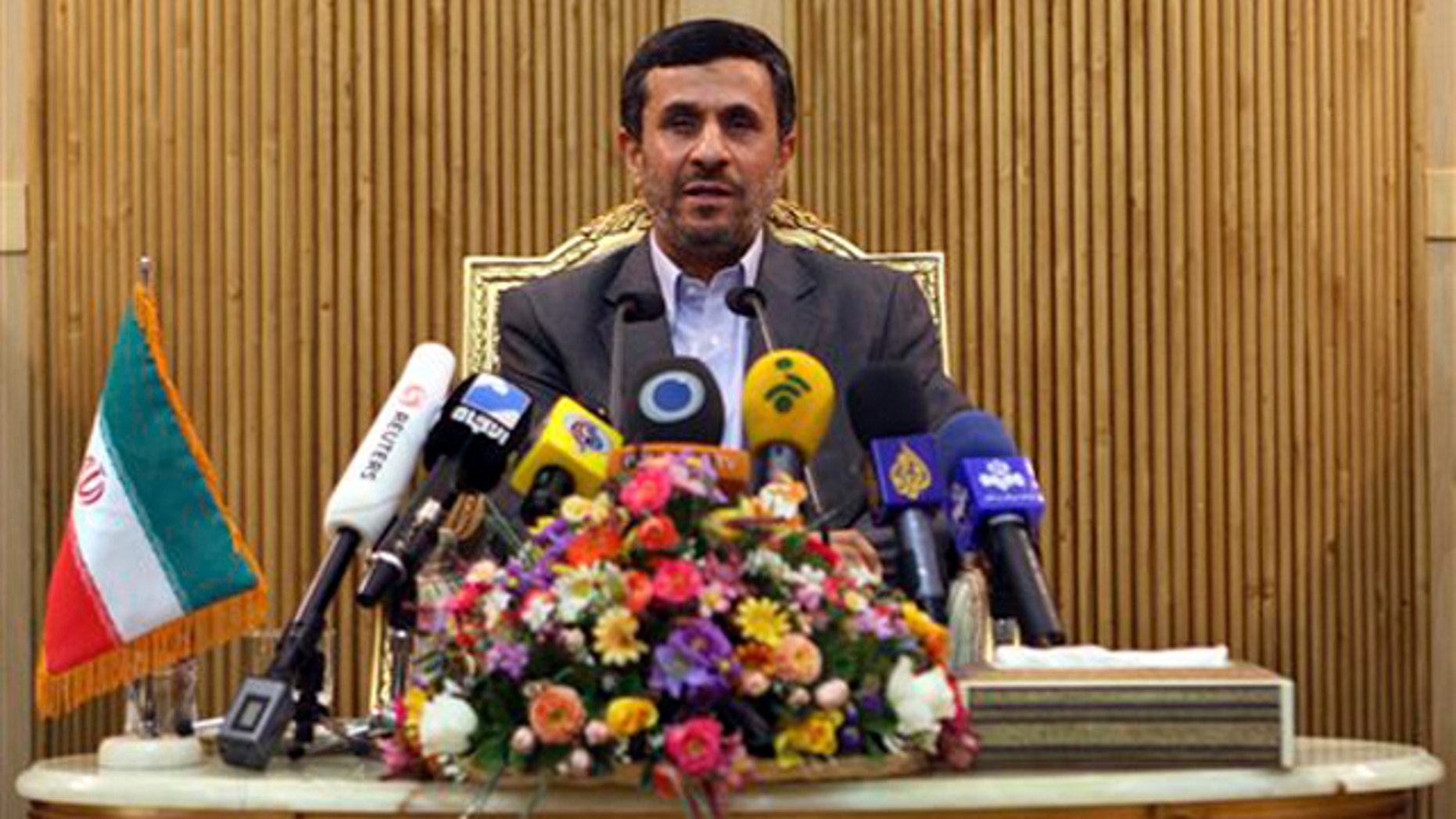 Sept. 4: Iranian President Mahmoud Ahmadinejad briefs the media, prior to departing Tehran's Mehrabad airport for a trip to Tajikistan.